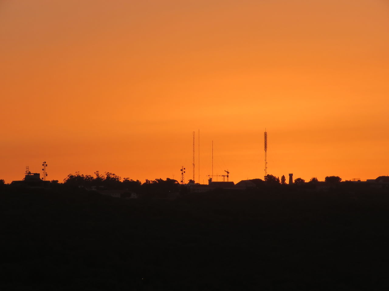 sunset, silhouette, orange color, connection, communication, technology, antenna - aerial, no people, satellite dish, built structure, nature, sky, telecommunications equipment, beauty in nature, global communications, scenics, outdoors, television aerial, architecture, tree, building exterior
