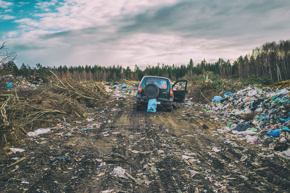 At the city garbage dump. The official garbage dump of the village. Abandoned Cloud - Sky Damaged Garbage Land Vehicle Nature No People Outdoors Waste Management