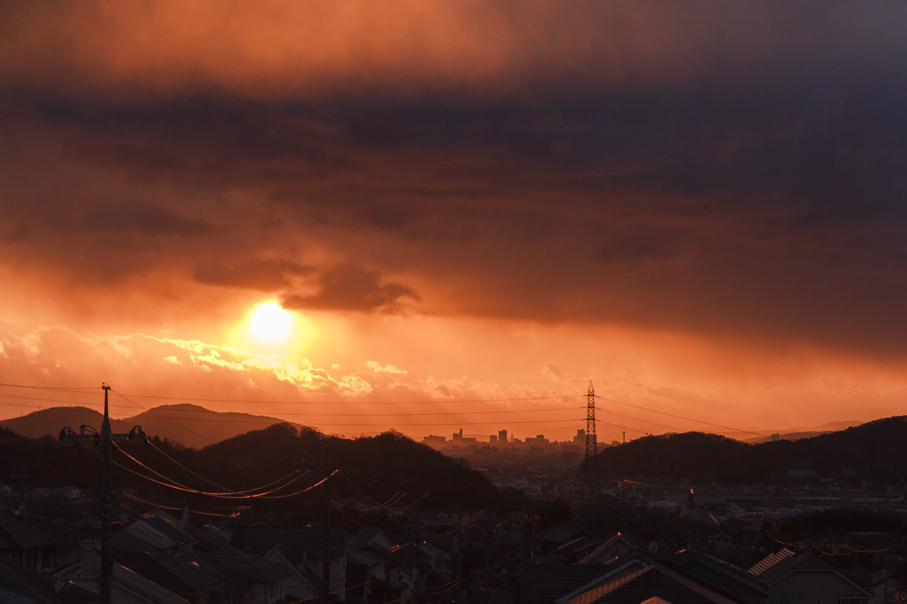 Attic sunsets. I need to climb up into the attic to take winter sunset pics. Alternative Energy Architecture Beauty In Nature Cloud - Sky Dramatic Sky Electricity  Electricity Pylon Mountain My Home My Neighborhood Nature Neighborhood No People Outdoors Scenics Sky Storm Cloud Sunset Sunset And Clouds  Sunset Silhouettes Sunset_collection Sunsetporn Sunsets 鉄塔♡Love