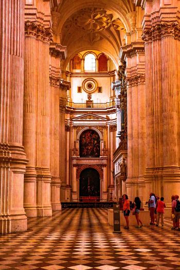 Inside of the cathedral in Seville Cathedral Inside Men Architecture Built Structure Religion Travel Destinations Place Of Worship Adult People Indoors  Tourism Tourist