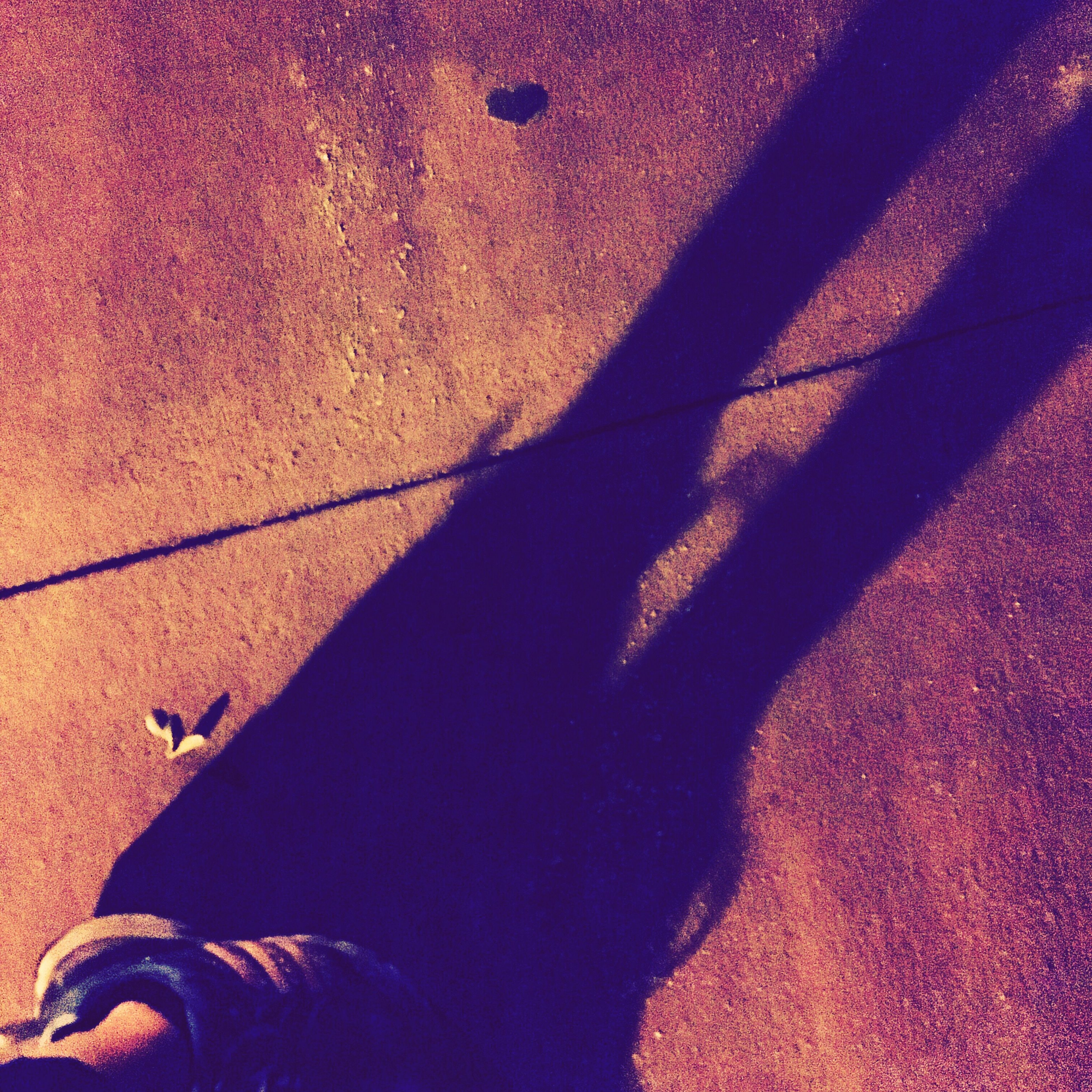 shadow, sunlight, low section, person, shoe, street, road, footwear, personal perspective, human foot, outdoors, day, focus on shadow