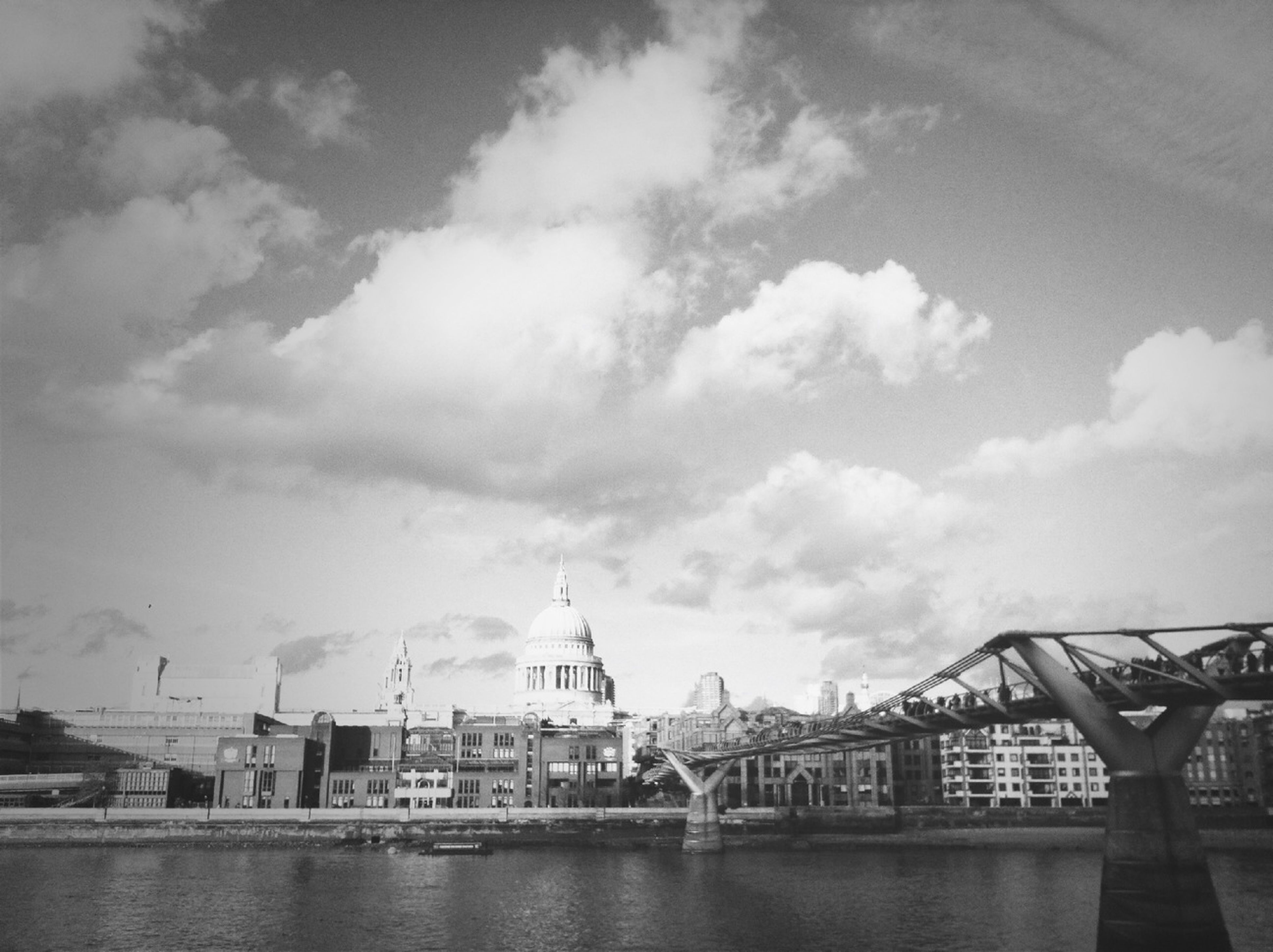 architecture, built structure, building exterior, sky, cloud - sky, water, waterfront, cloudy, nautical vessel, cloud, day, river, city, transportation, outdoors, weather, no people, crane - construction machinery, mode of transport, travel