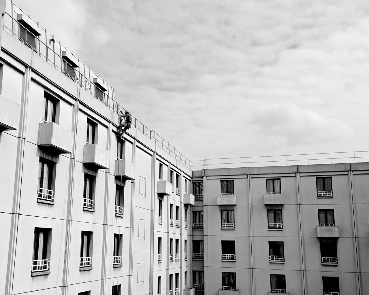 building exterior, architecture, built structure, window, residential building, outdoors, sky, no people, low angle view, day, city, cloud - sky, residential