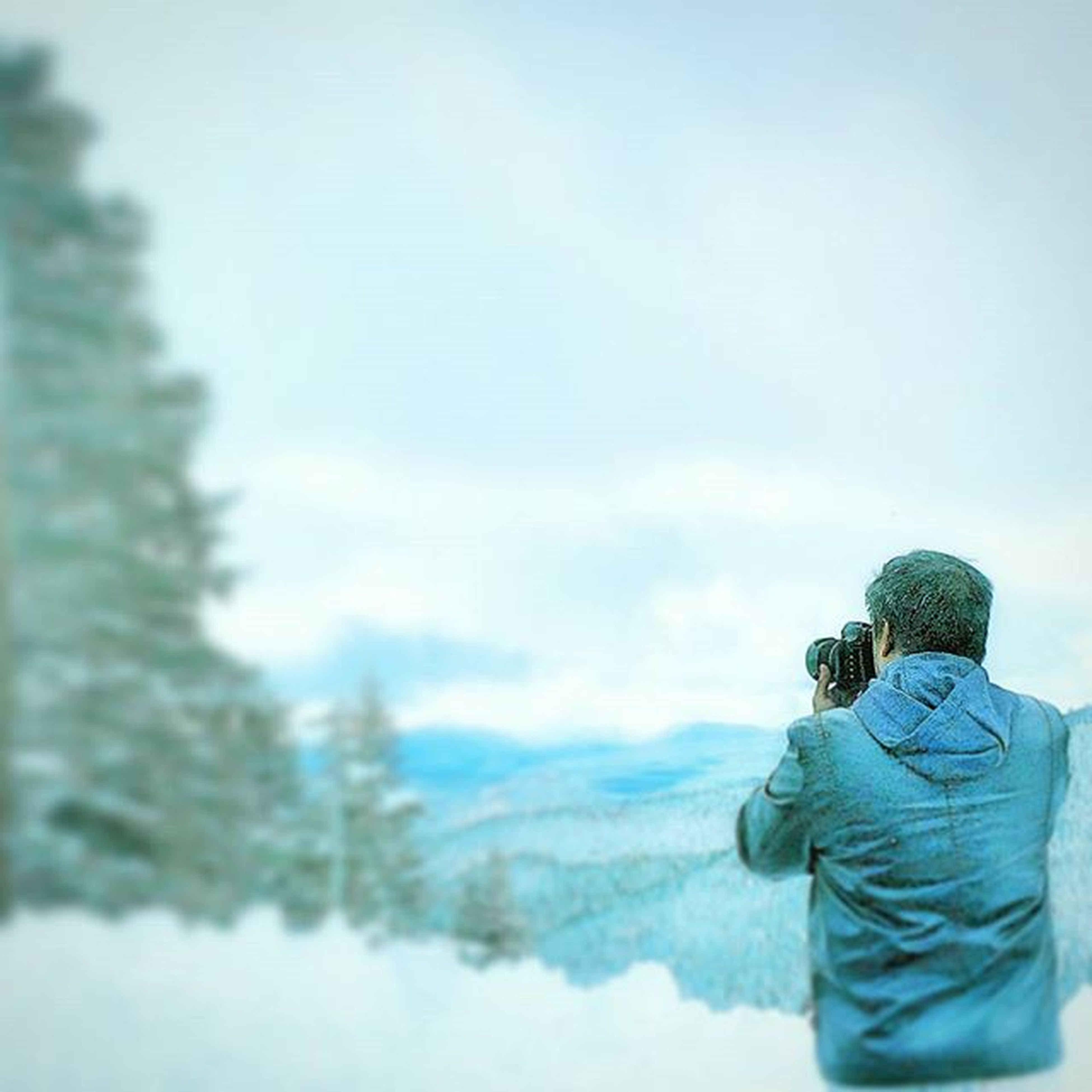 sky, lifestyles, men, weather, leisure activity, mountain, rear view, winter, cloud - sky, standing, cold temperature, snow, tranquility, nature, focus on foreground, day, tranquil scene, outdoors