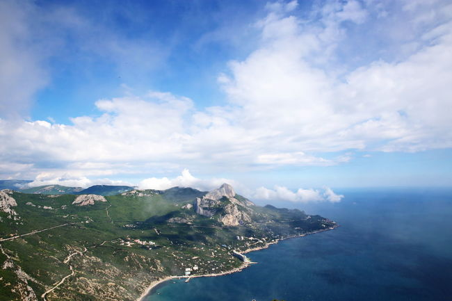 Aerial View Beauty In Nature Cloud Cloud - Sky Cloudy Coastline Day Flowers Hiking Idyllic Landscape Majestic Mountain Mountain Range Nature Non-urban Scene Outdoors Remote Sea Sky Traveling Water