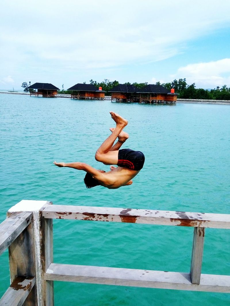 Water Jumping Full Length One Person Young Adult Outdoors One Woman Only Exercising Adults Only Motion Grace Agility Swimming Pool Sky People Adult Day Flexibility Only Women Cloud - Sky Bokoriisland Kendari