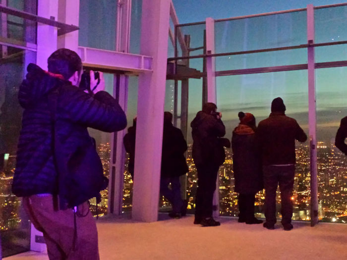 A sneaky shot of this photographer and others enjoying the wonderful view of The Shard, while I was stood at the bar ordering a Hot Chocolate! Check This Out Enjoying Life The Shard Theshard Skyline Streamzoofamily City Of London People Watching Lights London Enjoying The View View From The Shard From My Point Of View The Shard By Night