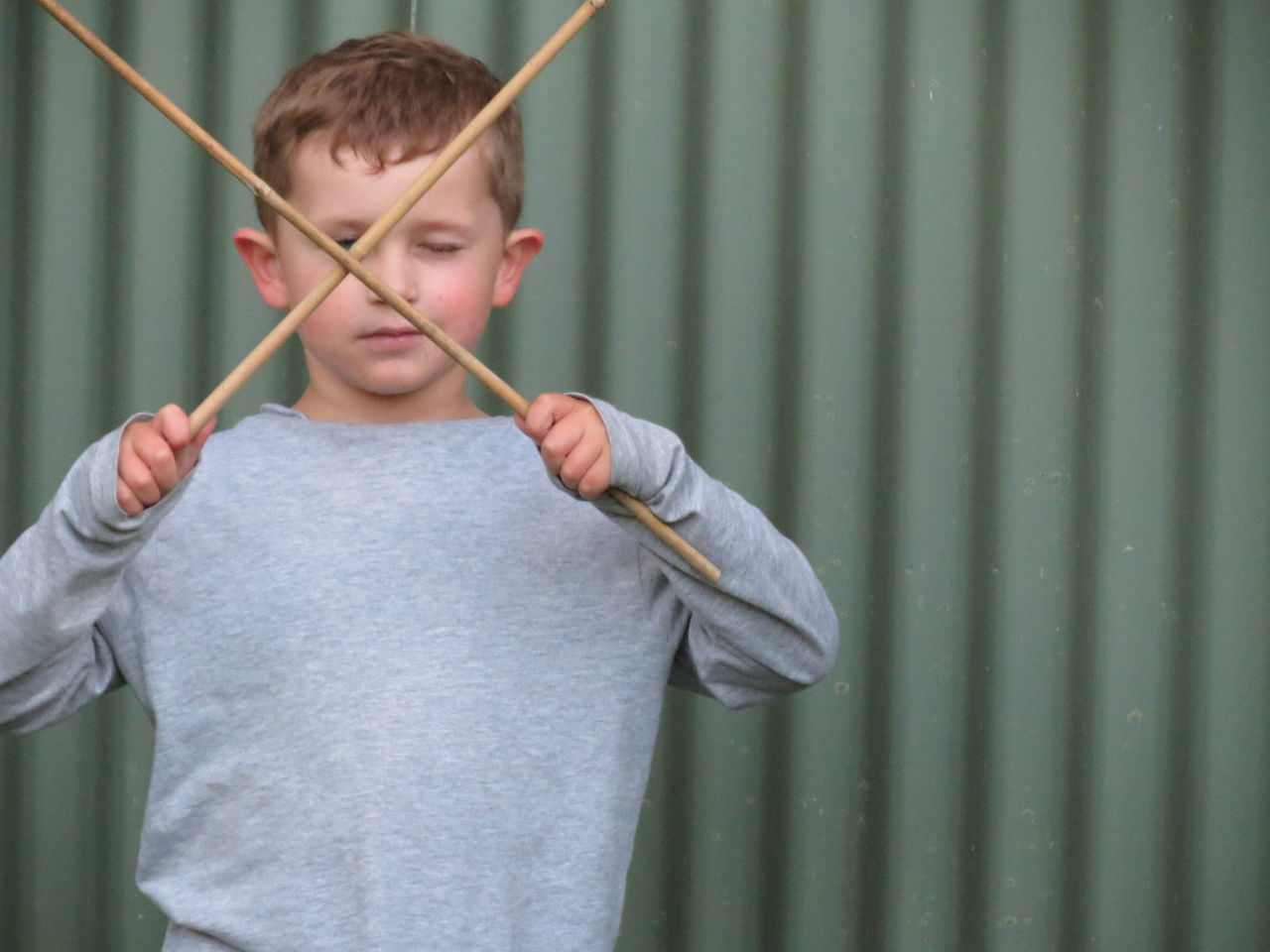 Playing Child People One Person Boys Indoors  Human Body Part Standing Day Human Hand Children Only Close-up Bamboo Sticks Defiance Resistance  Growing Up Trouble Family Targeting Aiming Resist TCPM