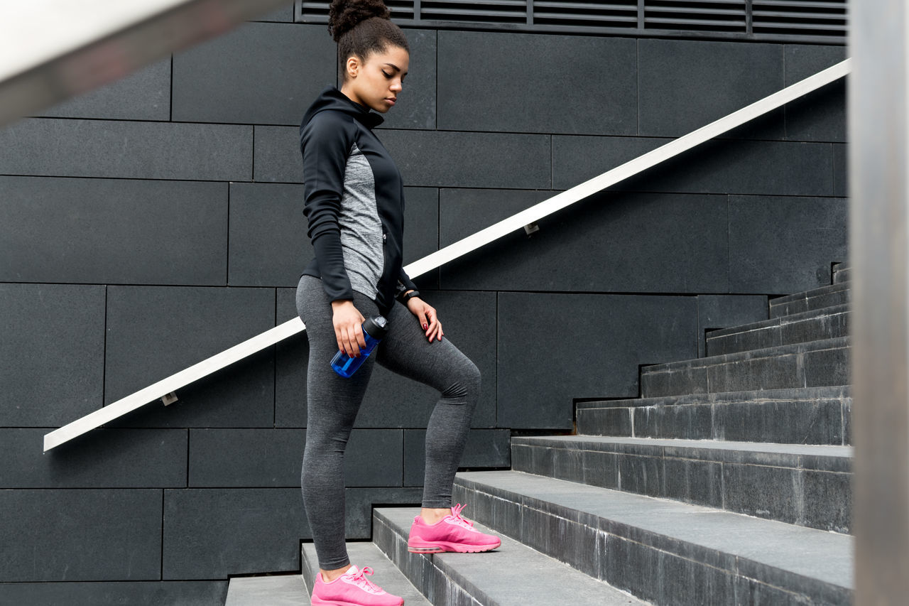 Adults Only Athlete Bottle Break Built Structure Day Female Fitness Full Length Healthy Jogger Lifestyles Mixed Race One Person Outdoors People Real People Running Club Sport Clothes Staircase Steps And Staircases Women Young Adult Young Women