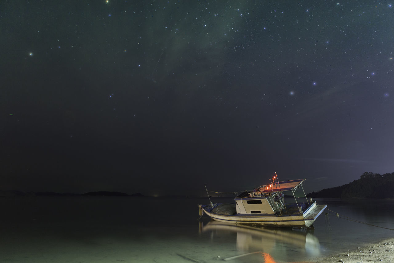nautical vessel, water, transportation, nature, night, mode of transport, beauty in nature, waterfront, tranquility, scenics, moored, outdoors, no people, star - space, sky