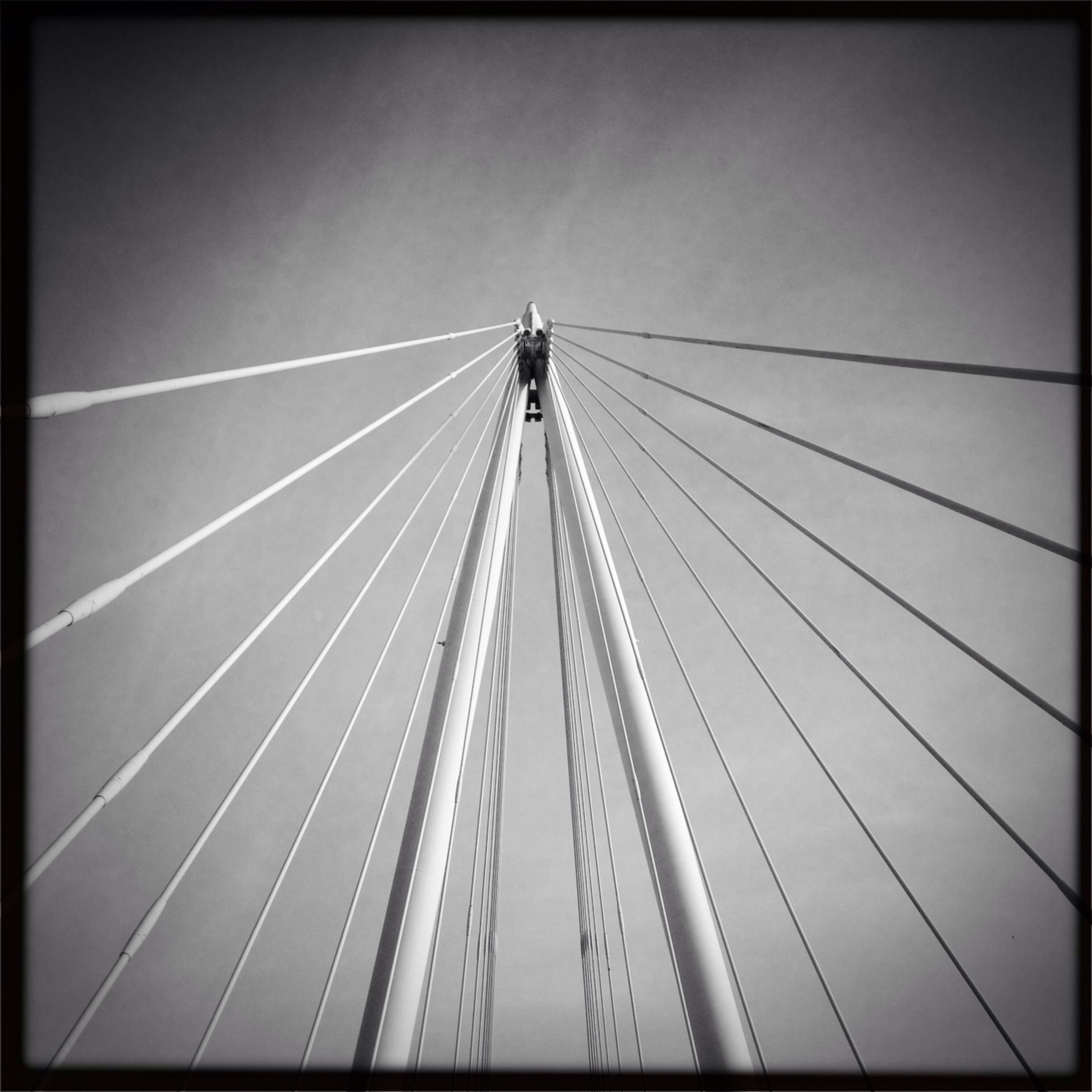 transfer print, clear sky, low angle view, auto post production filter, connection, transportation, sky, day, outdoors, built structure, engineering, no people, bridge - man made structure, copy space, diminishing perspective, travel, architecture, suspension bridge, the way forward, nature