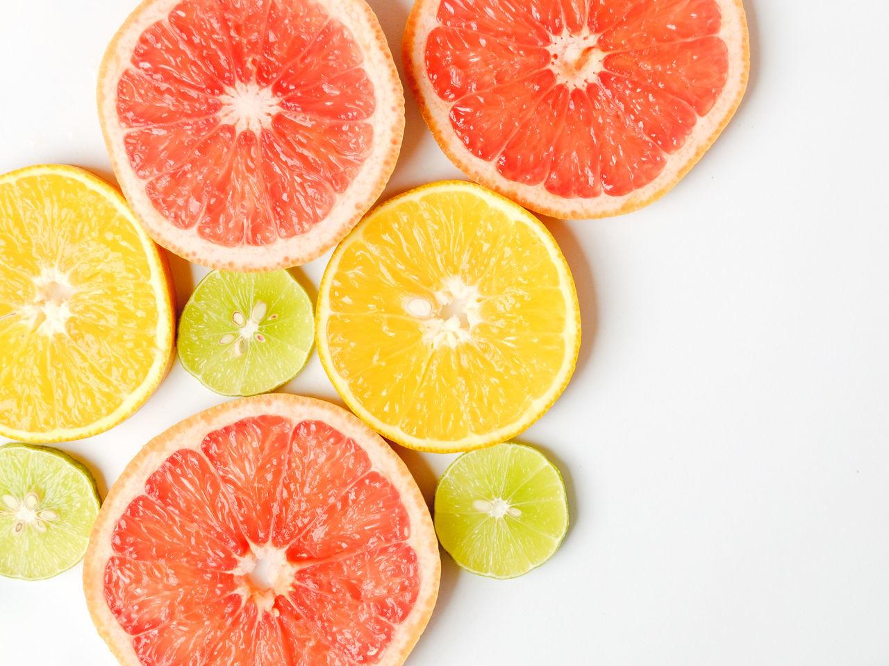 Blood Orange Citrus Fruit Cross Section Food Food And Drink Freshness Fruit Grapefruit Healthy Eating High Angle View Large Group Of Objects Lemons Lime Orange Fruit SLICE Sour Taste Studio Shot White Background