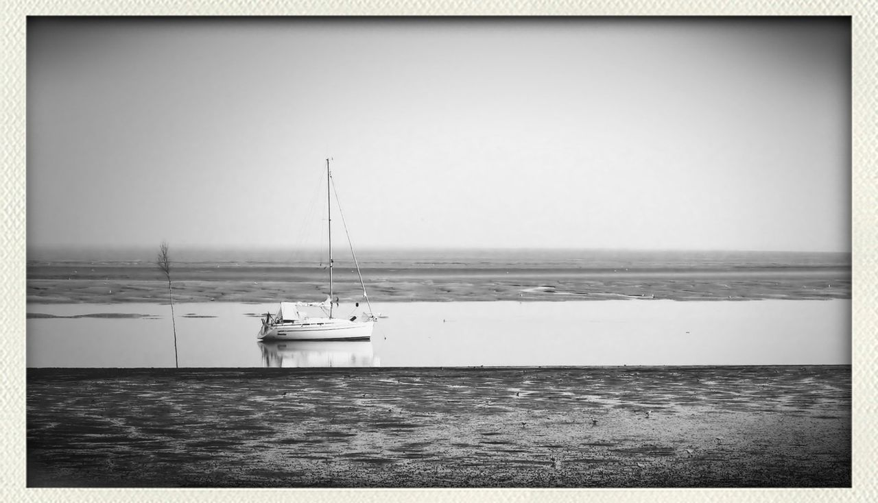 sea, auto post production filter, water, horizon over water, nautical vessel, transportation, tranquility, day, nature, scenics, tranquil scene, beauty in nature, outdoors, sky, clear sky, no people, beach, sailing, yacht