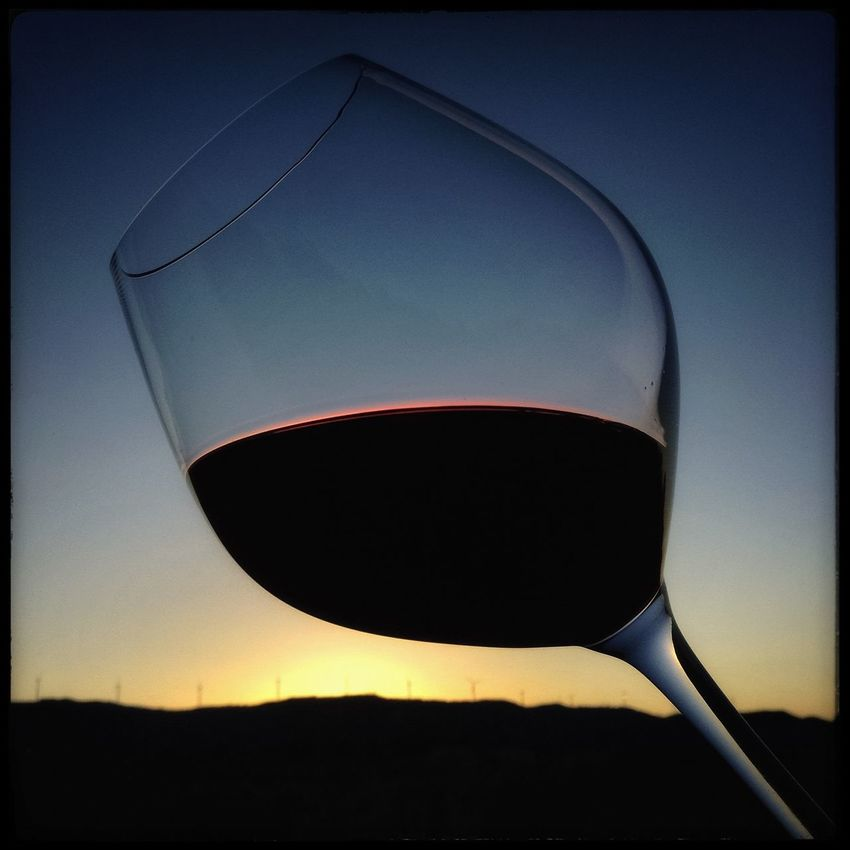 A glass of red Grenache wine against a setting Sun, Catalonia, Spain. Close-up Drinks Health Low Angle View Red Wine SPAIN Spain ✈️🇪🇸 Spain♥ Sunset Sunset Silhouettes Sunset_collection Sunsets Wine Wine Collection Wine Country Wine Glass Wine Moments Wine Tasting Wine Time Wineandmore Wineglass Wines Winestagram