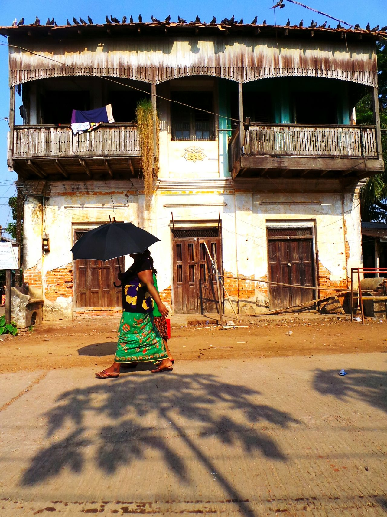 Miss Sunshine. Architecture Building Exterior Built Structure Full Length Lifestyles Shadow Casual Clothing Umbrella On The Go  Hot Summer Day Mwalamyine Myanmarstreetphotography Myanmar Myanmarphotos Myanmararchitecture Outdoors