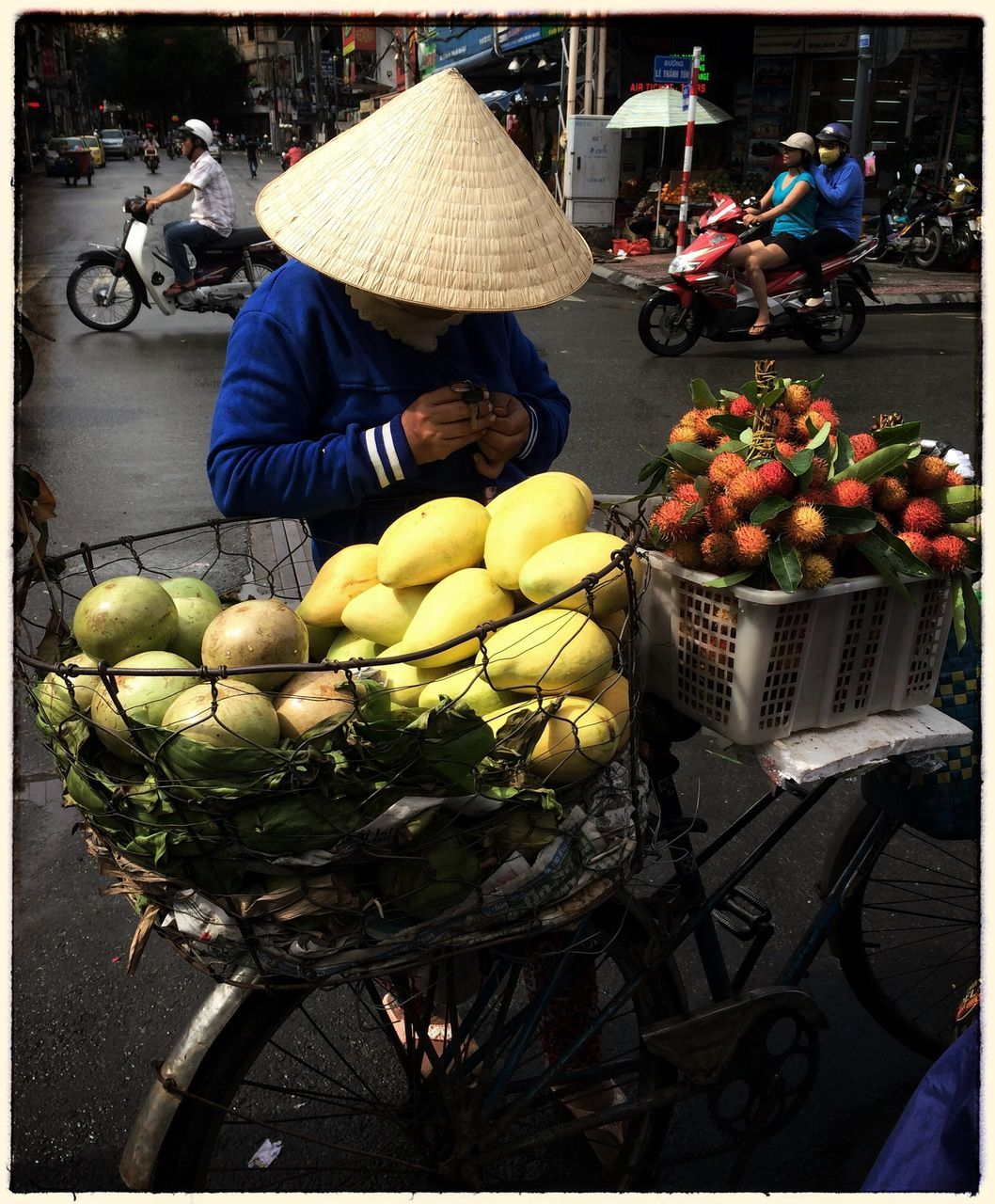 Man In Conical Hat Selling Fruits