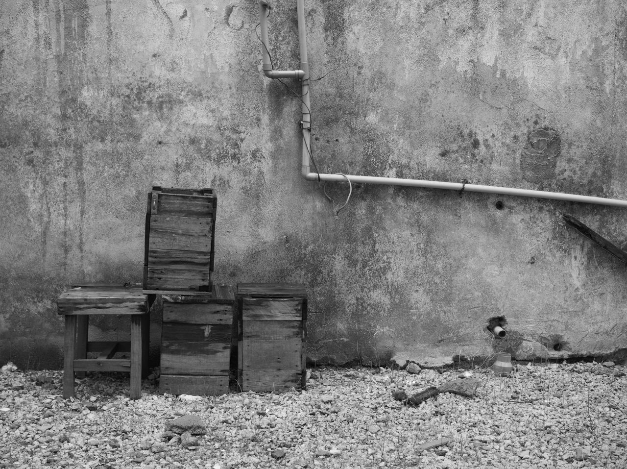 Table And Box On Field Against Wall