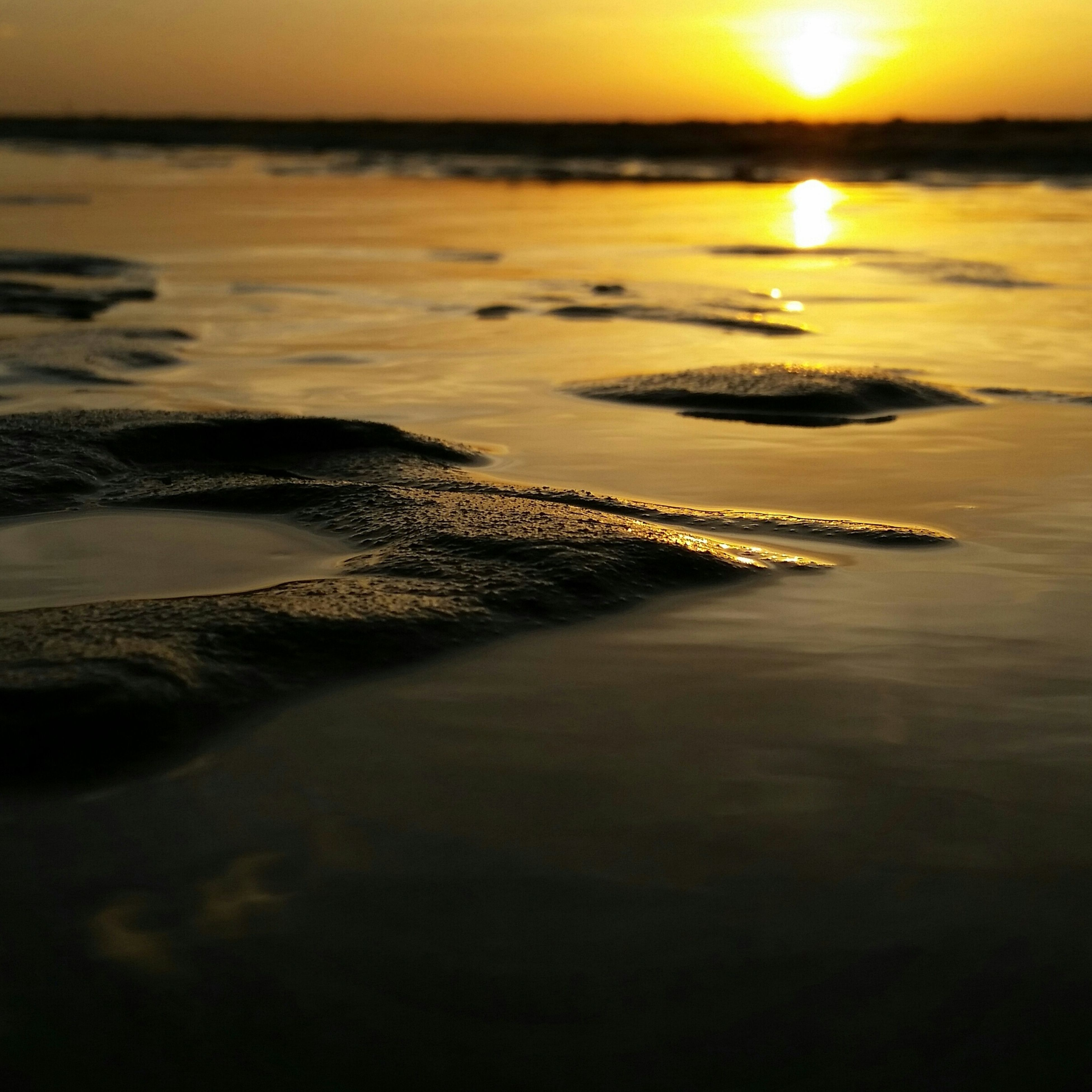sea, water, sunset, horizon over water, scenics, tranquil scene, beach, tranquility, beauty in nature, shore, sun, idyllic, reflection, nature, sky, wave, orange color, coastline, seascape, sunlight