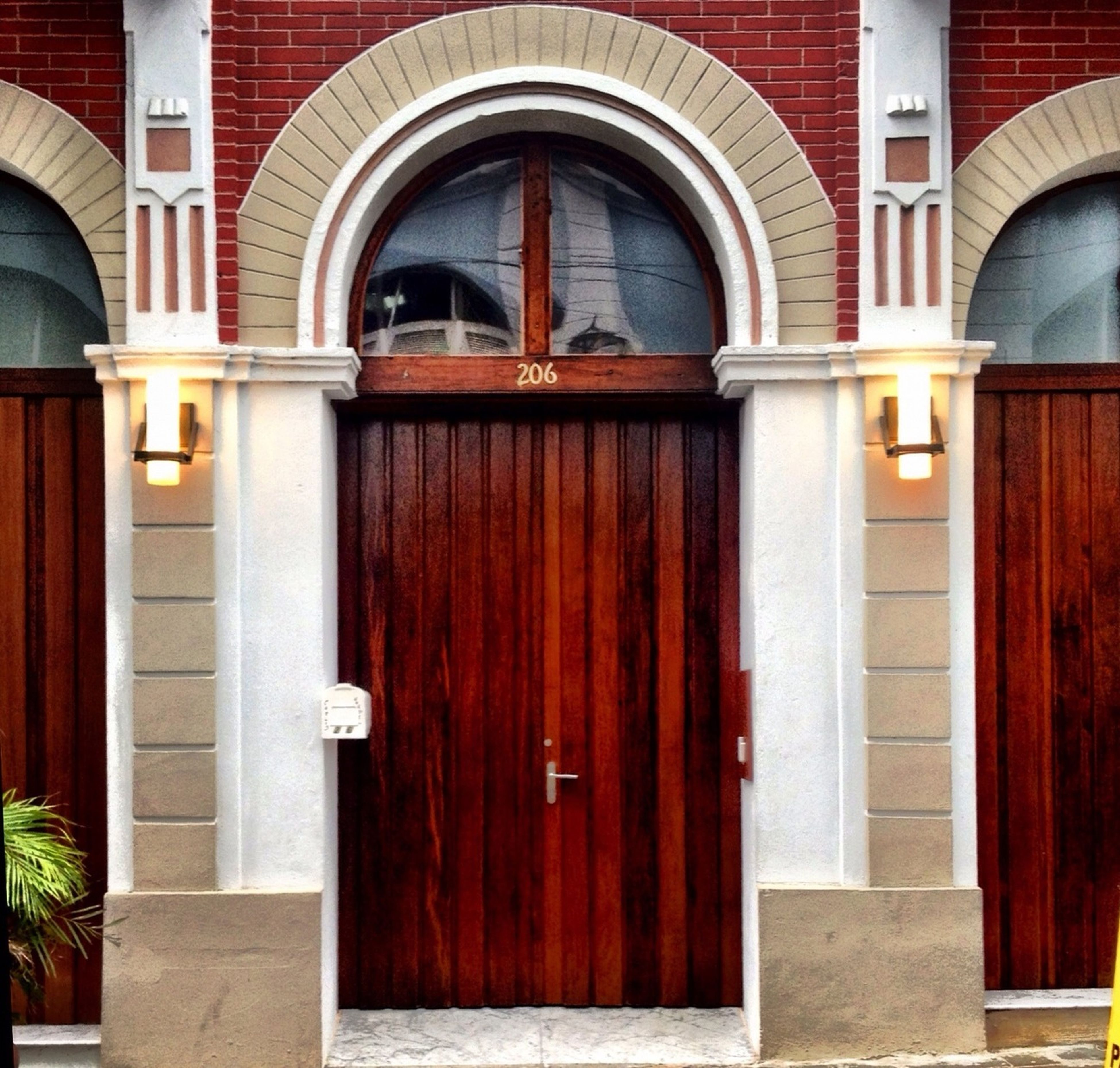 architecture, arch, built structure, building exterior, door, entrance, closed, window, house, building, facade, red, architectural column, gate, residential structure, day, outdoors, protection, safety, city