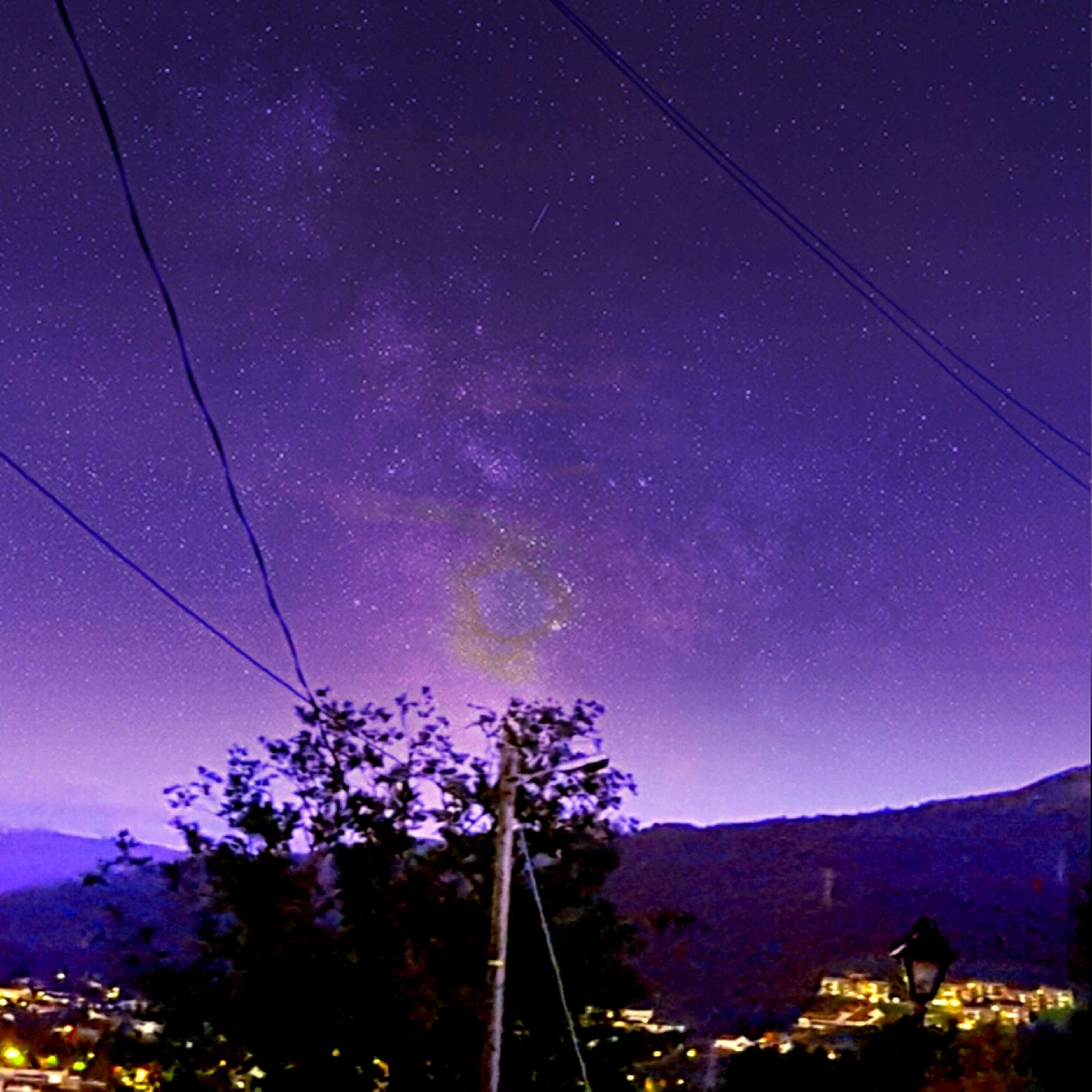 night, illuminated, low angle view, sky, tree, scenics, beauty in nature, astronomy, blue, nature, tranquility, tranquil scene, outdoors, mountain, infinity, dark, landscape, idyllic, no people, majestic, cable