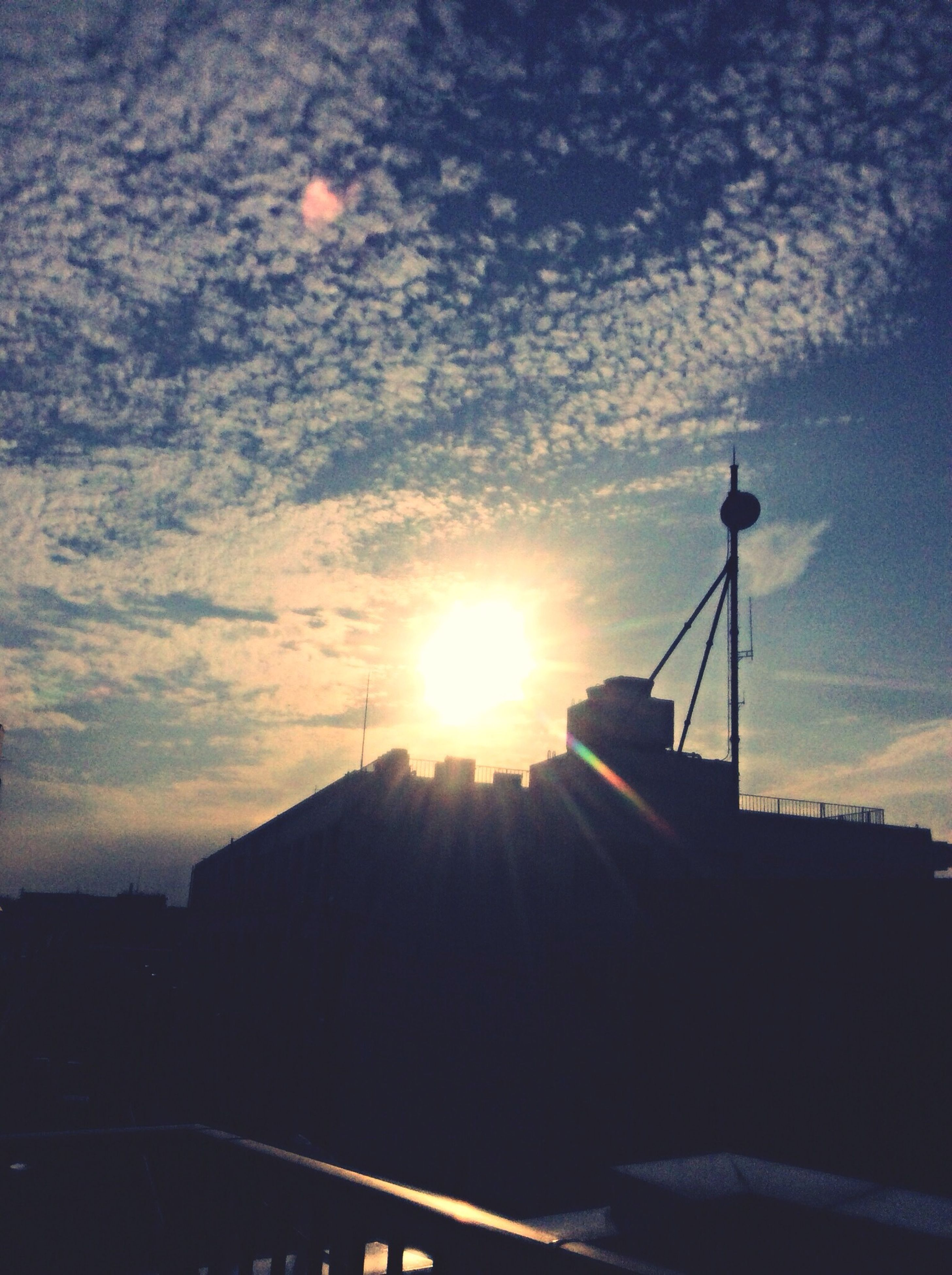 sky, silhouette, sun, cloud - sky, sunset, sunbeam, sunlight, low angle view, cloud, street light, cloudy, built structure, lens flare, nature, transportation, architecture, outdoors, beauty in nature, scenics, building exterior