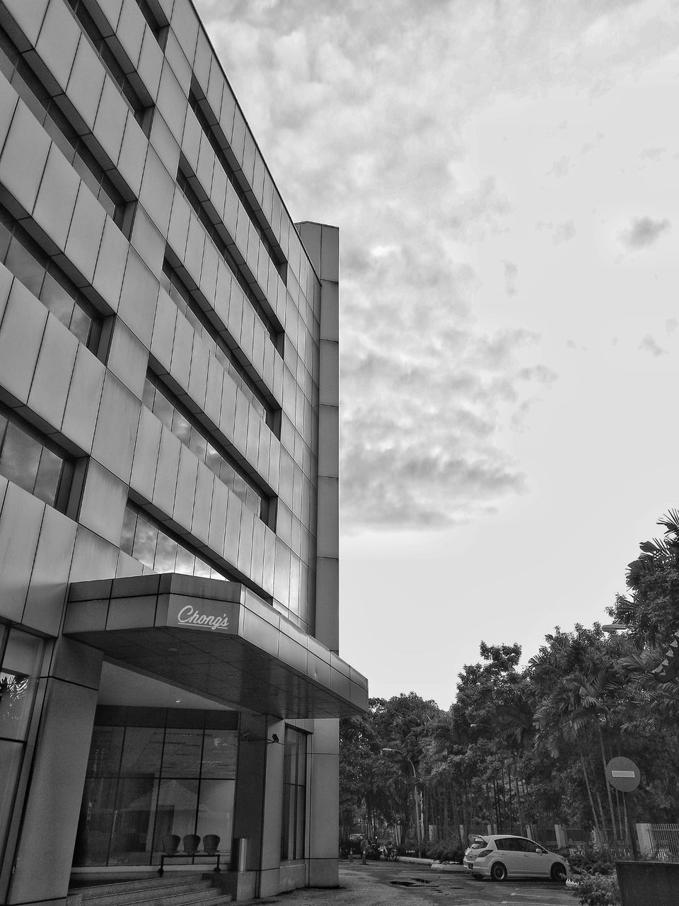 architecture, sky, building exterior, built structure, cloud - sky, outdoors, day, tree, car, low angle view, no people, city