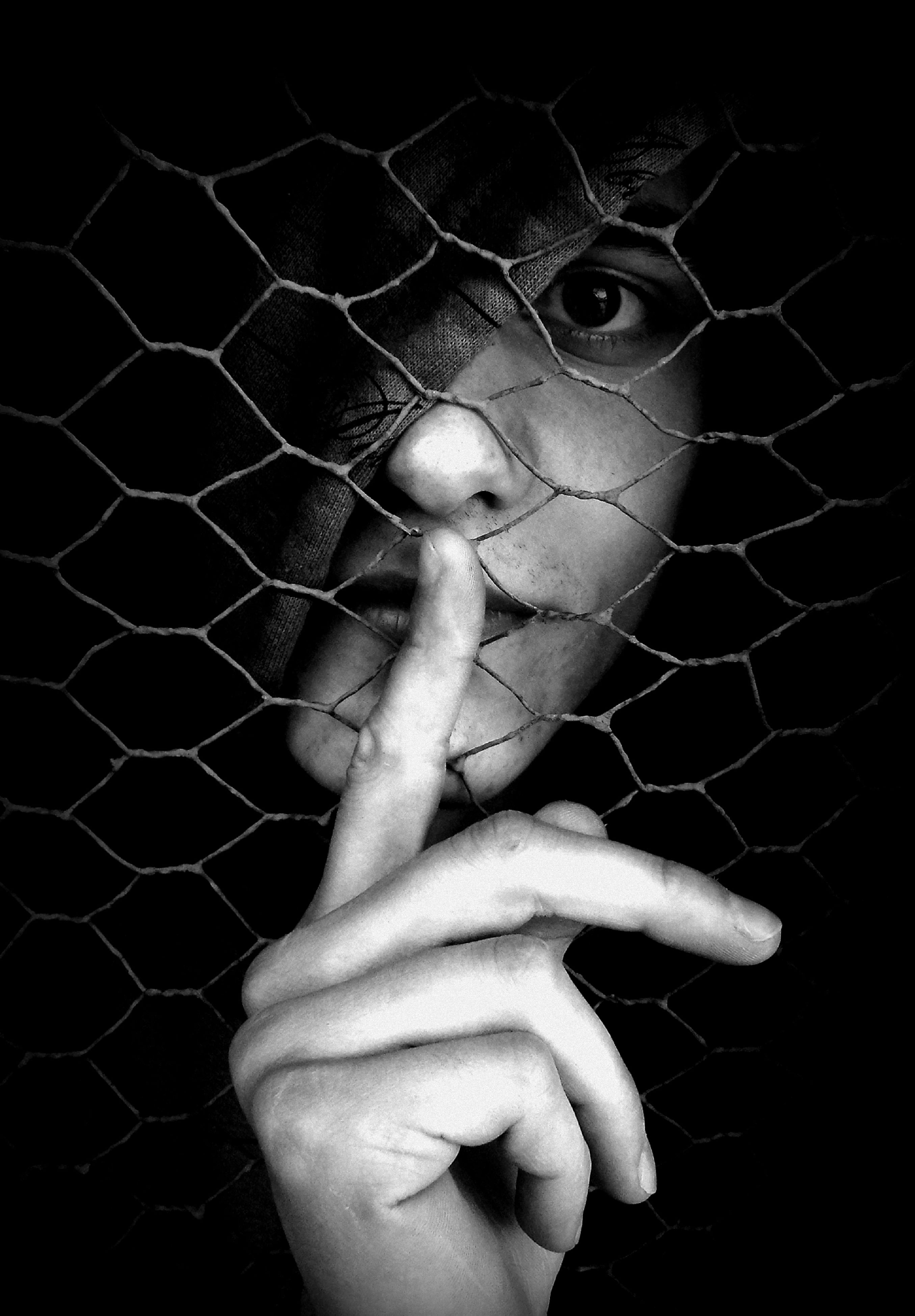 human hand, one person, real people, human body part, black background, lifestyles, close-up, holding, animal themes, cage, indoors, day, people
