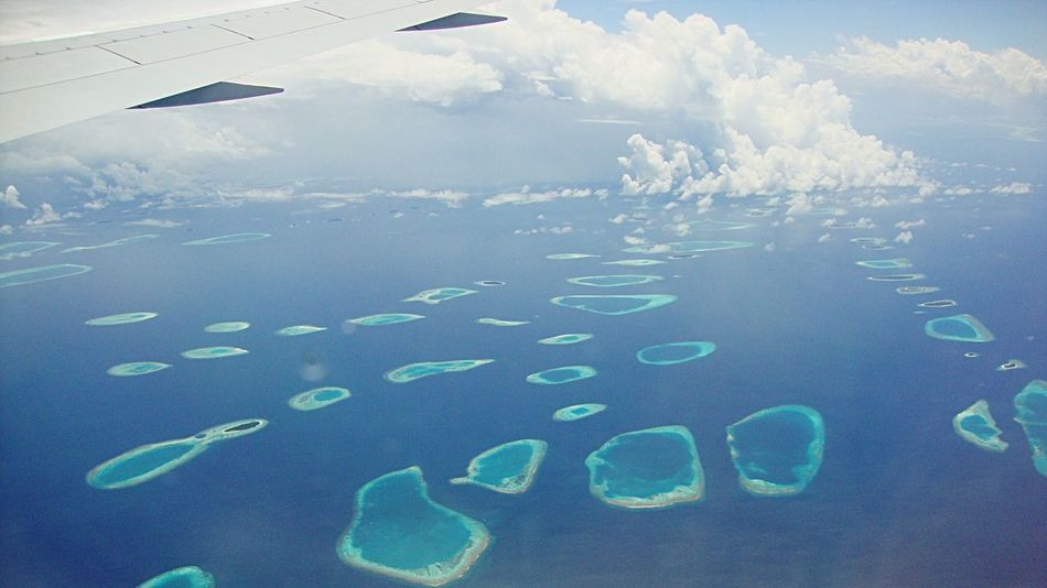 Jewels Of The Sea View From An Airplane View From An Aeroplane Maldives Flying Mode Of Transport Transportation Air Vehicle Under The Wing Sea Aerial View Aircraft Wing Cropped Blue Travel On The Move Water Landscape Cloud - Sky Scenics Ocean Journey Mid-air Island Islands From The Sky