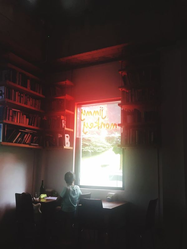 Indoors  Window Book One Person Real People Bookshelf Urban Cafe