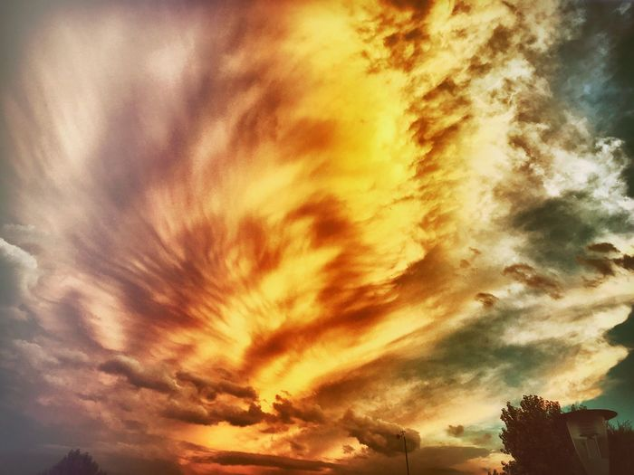 Beauty In Nature Low Angle View Sunset Scenics Cloud - Sky Sky Yellow Orange Color Nature Tranquil Scene Majestic Dramatic Sky Cloudscape Cloud Outdoors Cloudy Full Frame Atmospheric Mood High Section