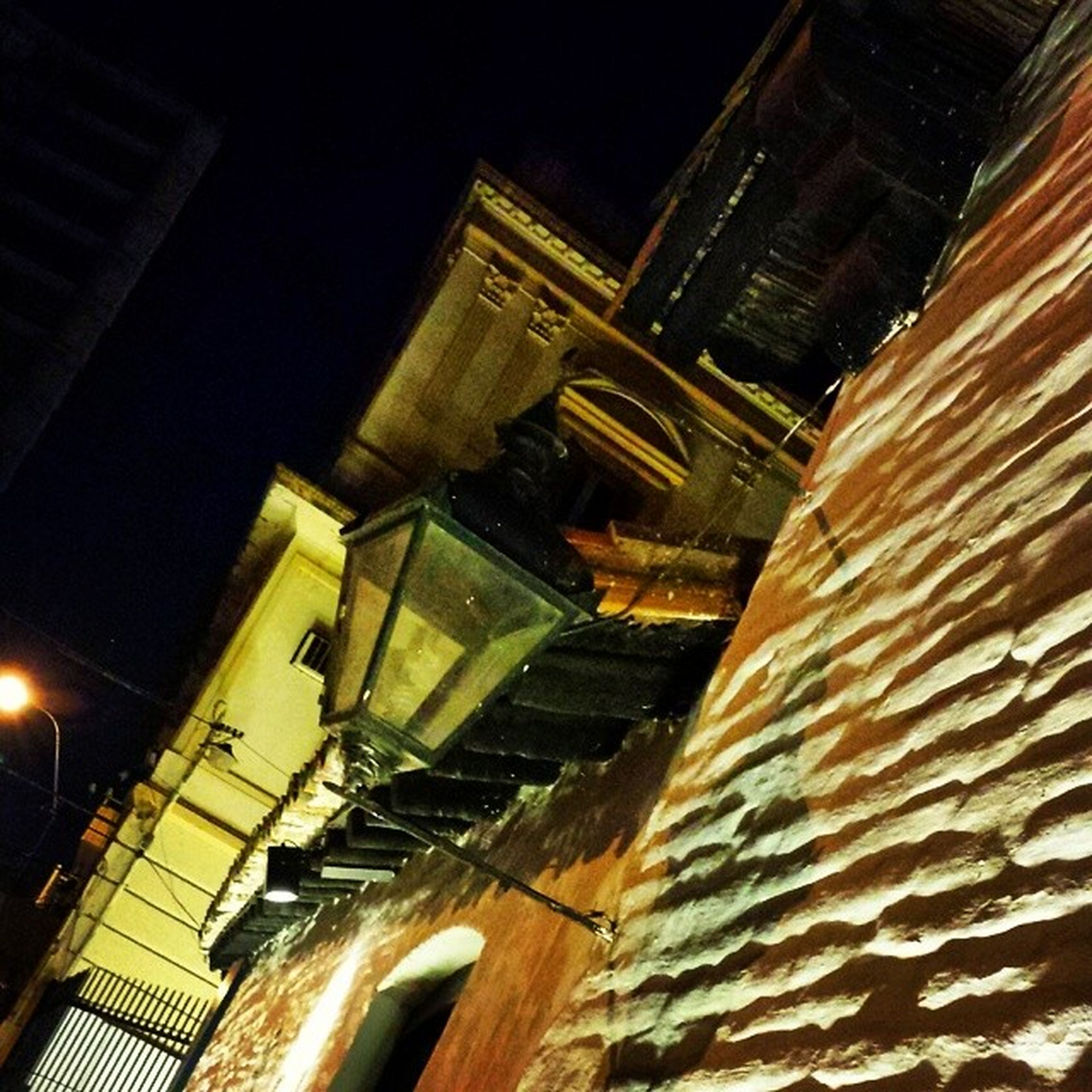 architecture, building exterior, built structure, night, illuminated, low angle view, city, building, residential building, tower, tall - high, sky, residential structure, outdoors, tilt, window, no people, city life, clear sky, skyscraper