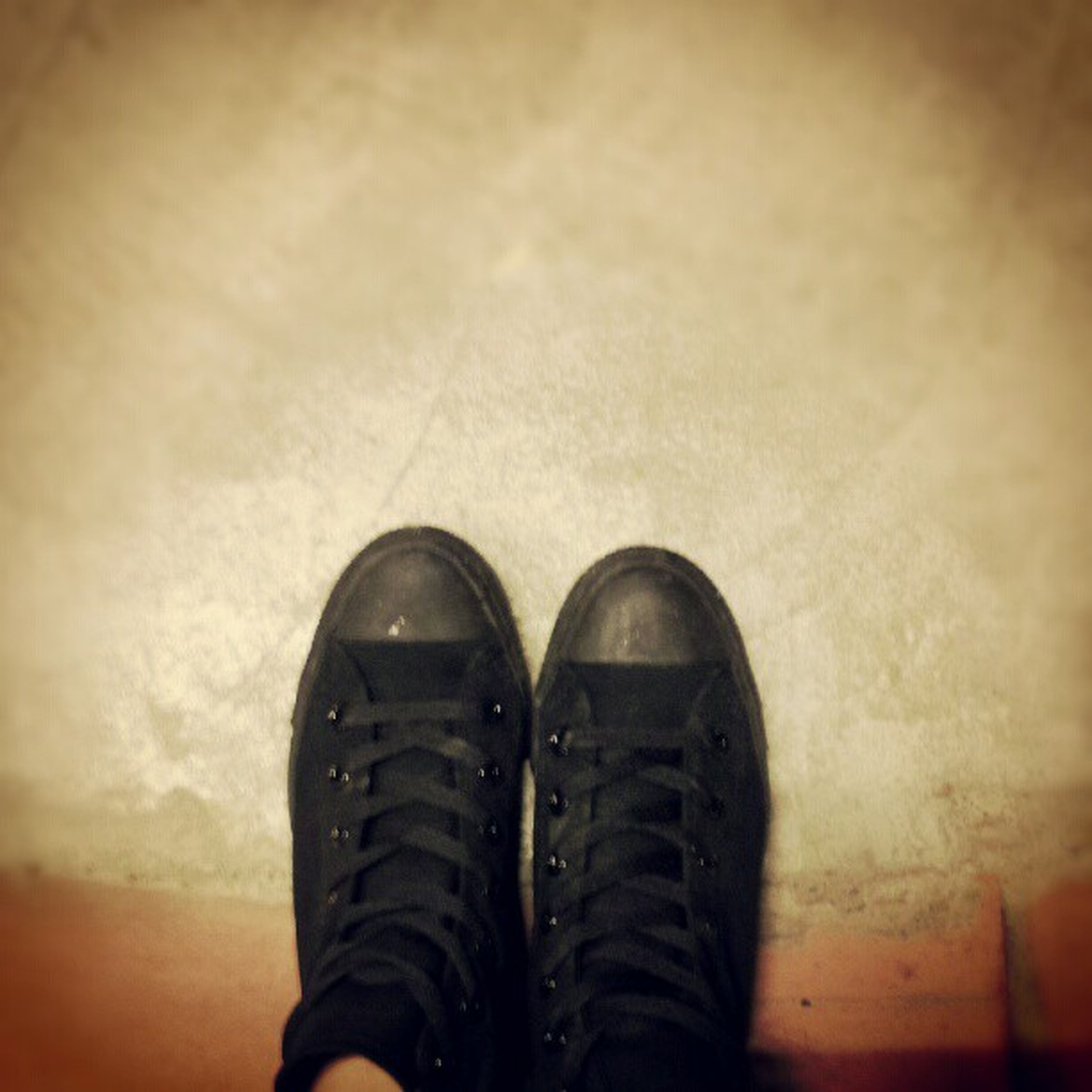 low section, shoe, person, personal perspective, human foot, standing, footwear, lifestyles, men, unrecognizable person, high angle view, jeans, part of, leisure activity, canvas shoe, indoors, floor