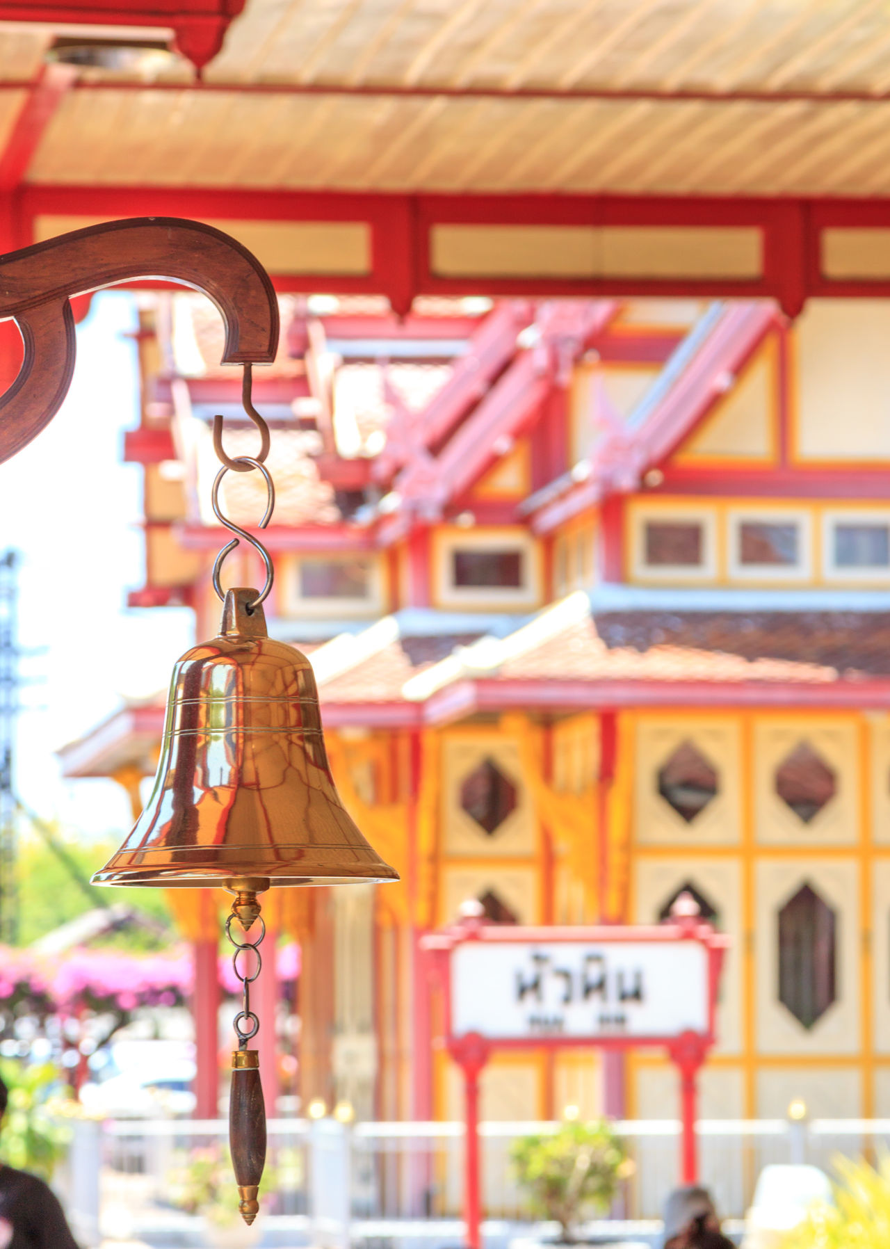 Hua Hin train station's bell and Thai flag Arrival Bell Built Structure City City Life Close-up Commuter Country Countryside Day Focus On Foreground Hanging Journey No People Outdoors Railway Station Railway Station Platform Ring Station Thai Culture Thailand Train Station Travel