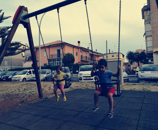 Childhood Playground Child Full Length Boys Playing Togetherness Outdoor Play Equipment Outdoors Girls Children Only Sky Swing Day Bonding People Friendship Color Photography 😆 Outdoor Photography Girl & Boy Altalena Altalena 😁