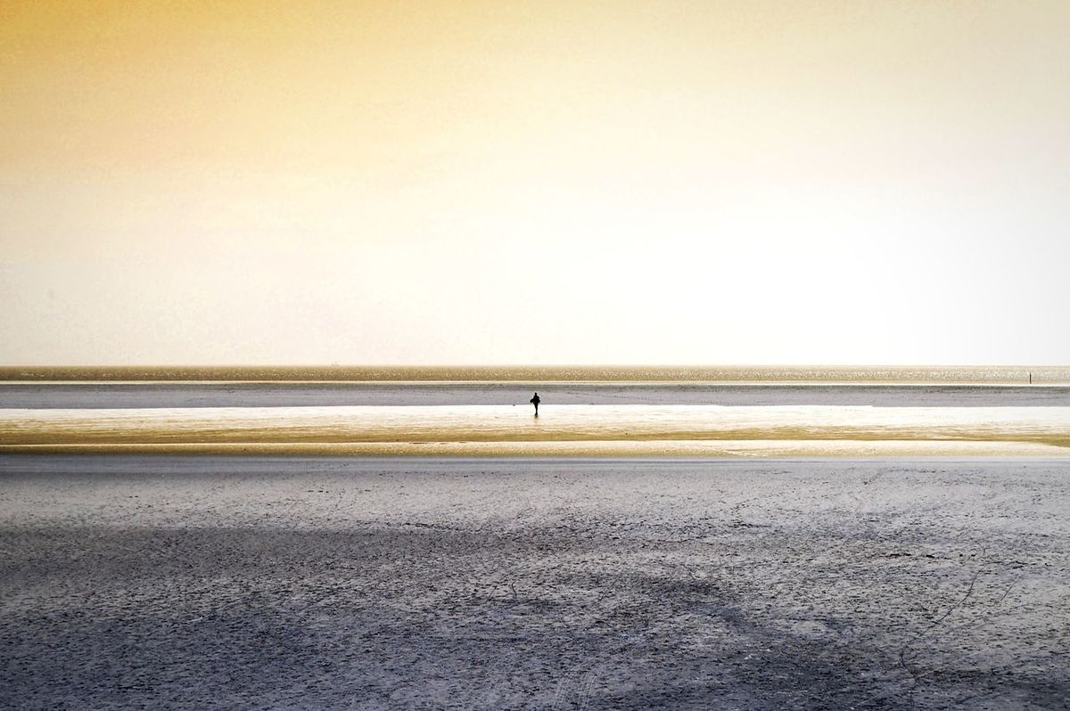 alone_time. Beach Sea Water Evening Evening Light Wide Landscape Landscape_Collection Landscape_photography Landscapes Alone Time Ebbe - Flut Horizon Over Water One Person Beauty In Nature Tranquility Clear Sky Sand Nature The Great Outdoors - 2017 EyeEm Awards Textures And Surfaces St. Peter Ording Lines Light Colorful