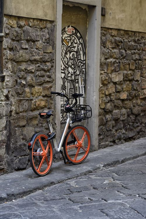 Bicycle Wall - Building Feature Transportation Mode Of Transport Architecture Built Structure Outdoors No People Day Street Stationary Building Exterior City Mural Art Red Wheels Cycle Environment Pavement Florence Italy The Best City In The World Italian Kerbside