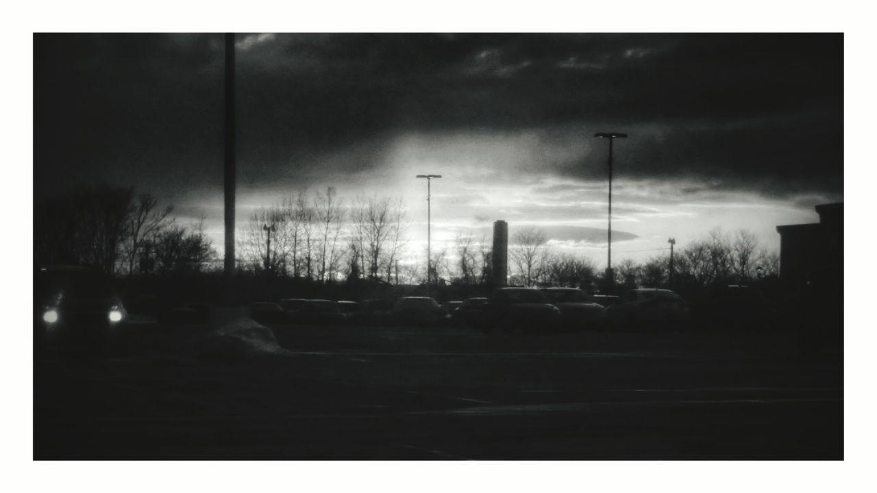 car, sky, transportation, land vehicle, cloud - sky, road, no people, outdoors, bare tree, smoke stack, tree, storm cloud, day