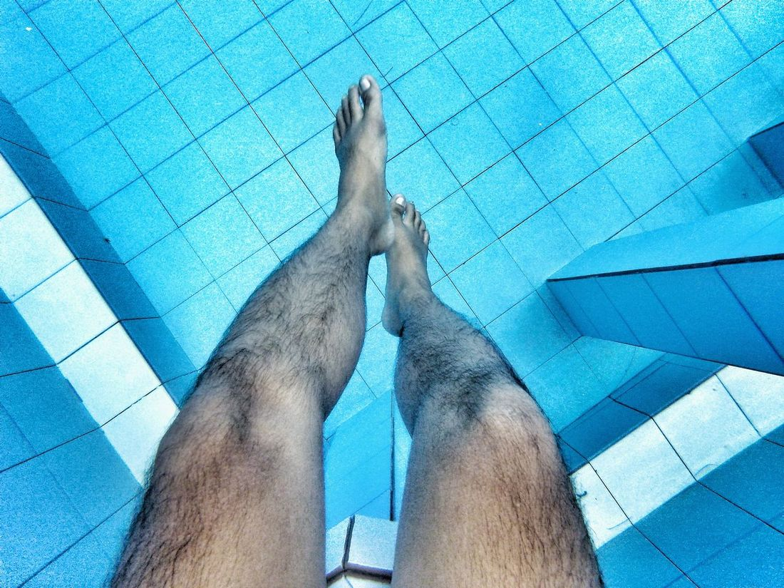 Chilling Low Section Lifestyles Real People Human Leg Blue Personal Perspective Swimming Pool Human Body Part Leisure Activity Water Men Body Care Day Outdoors Adult Bali, Indonesia