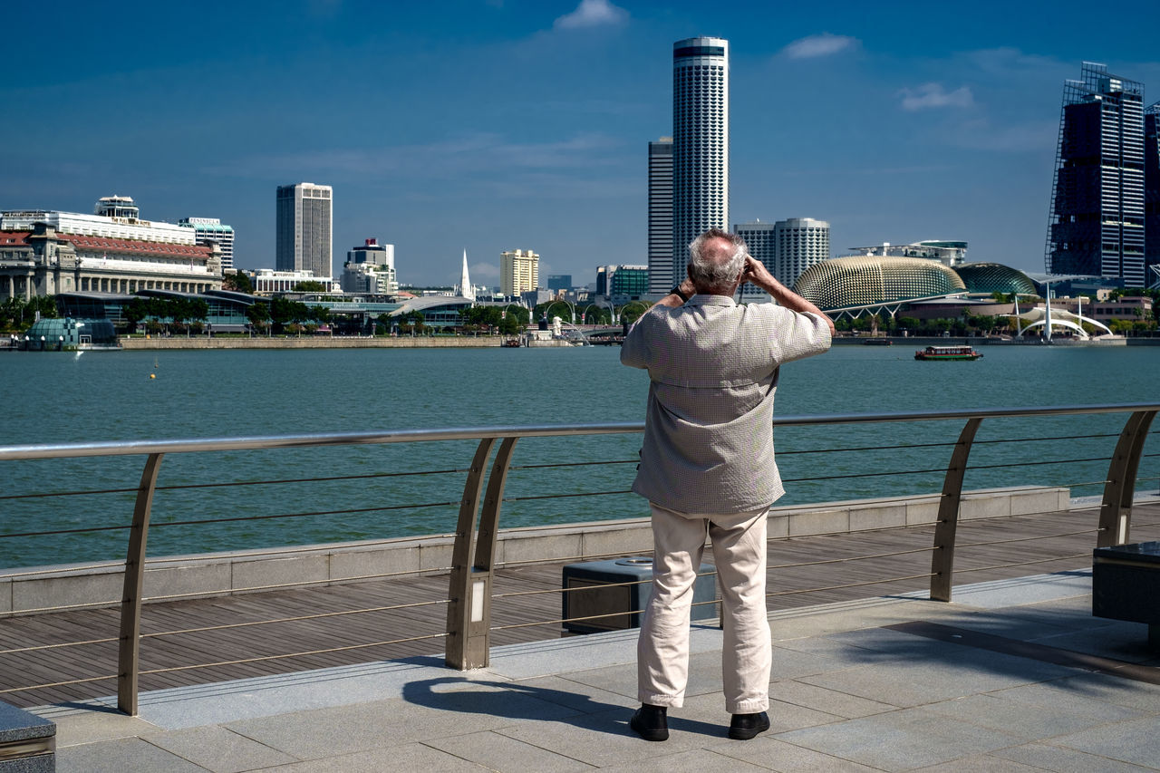 City One Man Only One Person Sky Skyscraper Rear View Full Length Outdoors Urban Skyline City Life Adult Cityscape Water Sea Day Street Photography Streetphoto_color Streetphotography Street Life Streetlife Everybodystreet Fujifilm X-Pro1