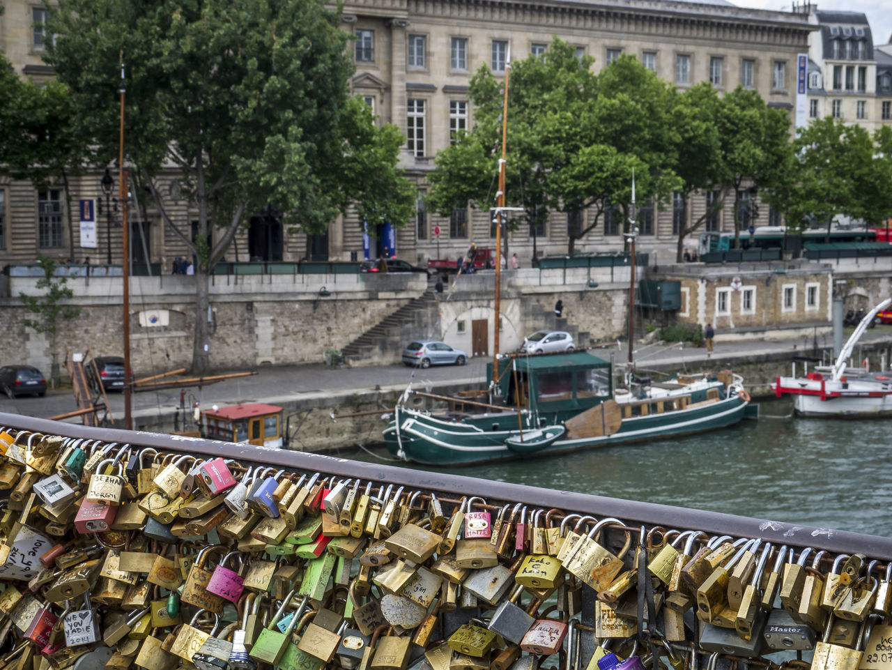 View of the Seine Architecture Bridge - Man Made Structure Building Exterior Built Structure City Day Hanging Hope Large Group Of Objects Lock Love Love Lock Nautical Vessel No People Outdoors Padlock Paris Protection Railing River Safety Seine Transportation Tree Water
