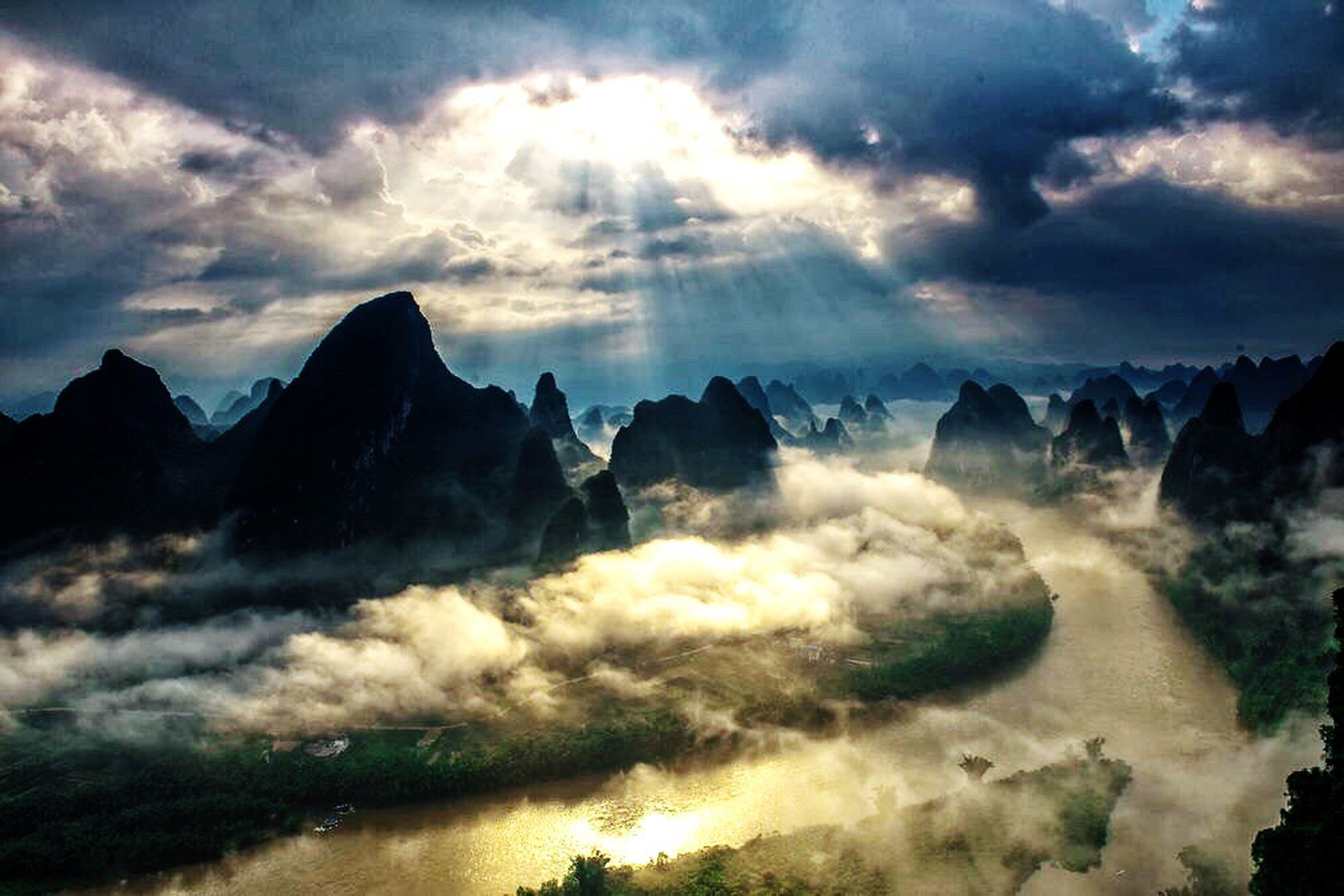 scenics, sky, beauty in nature, tranquil scene, cloud - sky, tranquility, cloudy, mountain, nature, idyllic, weather, cloud, majestic, cloudscape, mountain range, water, overcast, dramatic sky, outdoors, no people