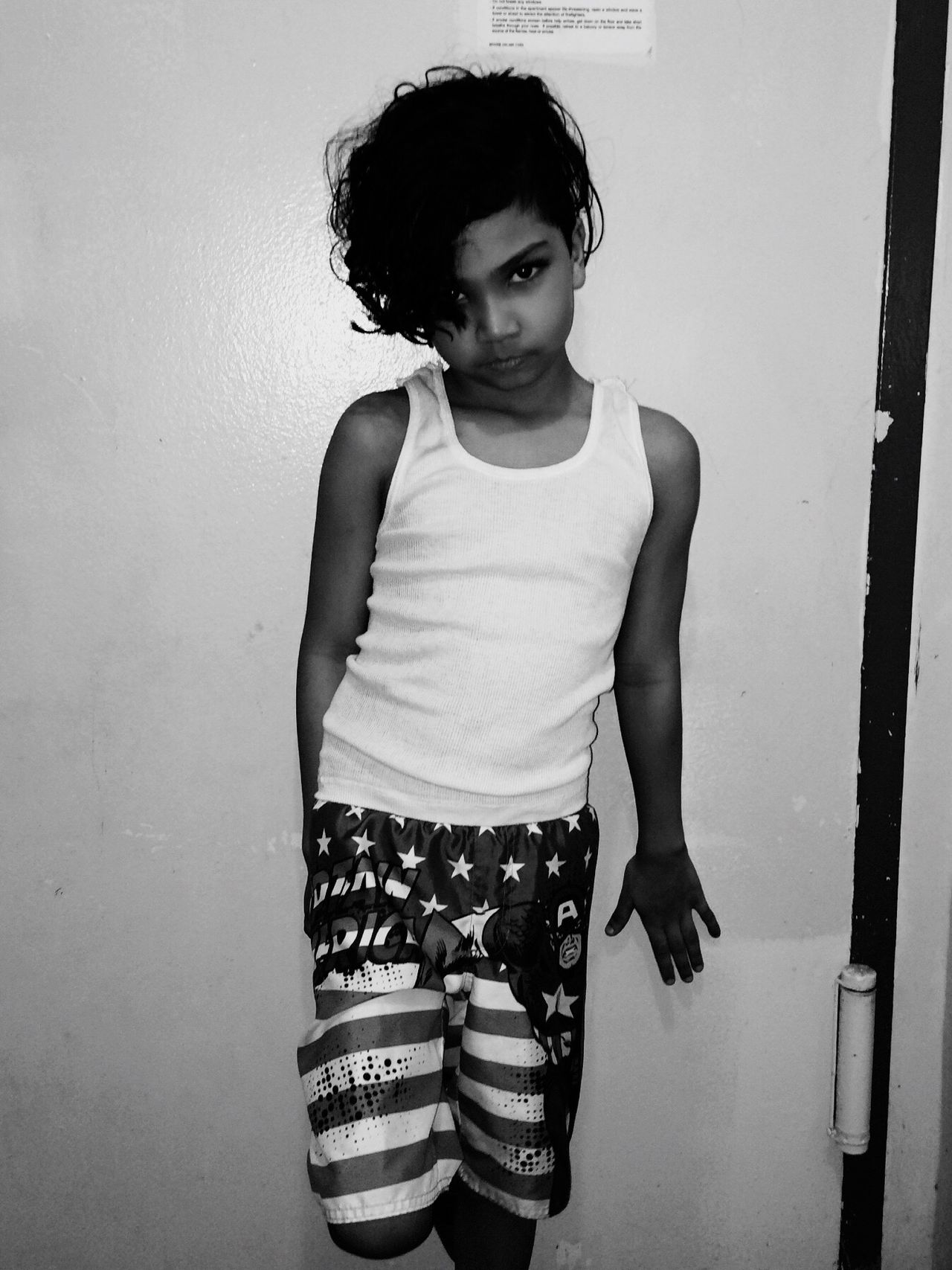 Posing and keeping focused Casual Clothing Innocence Elementary Age Standing Blackandwhite Model Focused Littleboy