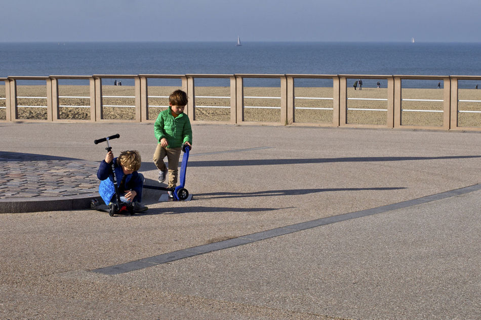 Best Friends Blue Boys And Their Toys Boys Will Be Boys Green Green And Blue Investigation Kids At Play Northsea Sea Seaside Shadows Streetphotography Streetlevel