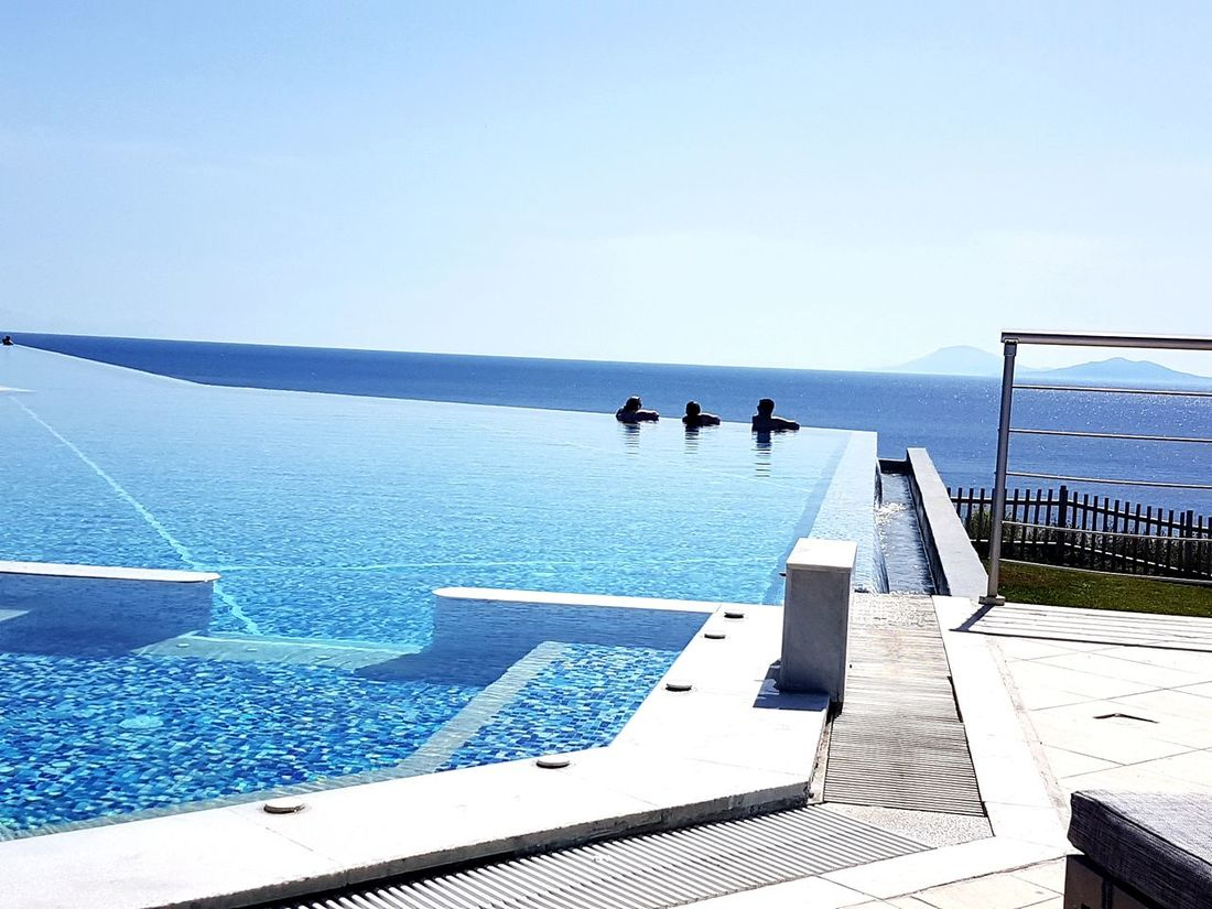 Samsung Galaxy S7 Edge Foto Sunlight Swimming Pool Greece Style Relaxation Luxury Sun Beauty In Nature Horizon Over Water Blue Vacations Nature Sky Water Sea Freshness