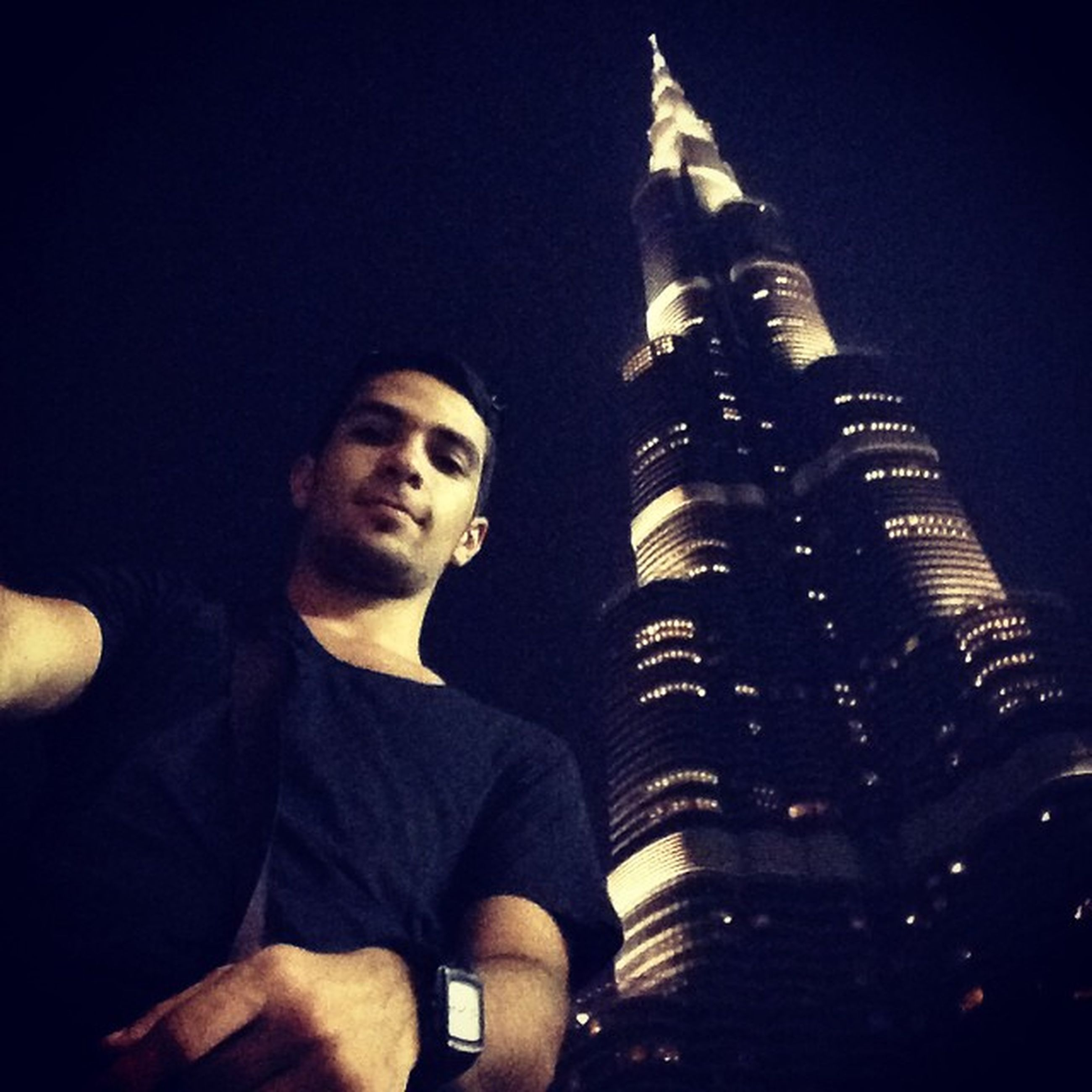 lifestyles, young adult, architecture, leisure activity, built structure, building exterior, standing, night, casual clothing, waist up, city, three quarter length, illuminated, looking at camera, person, young men, front view
