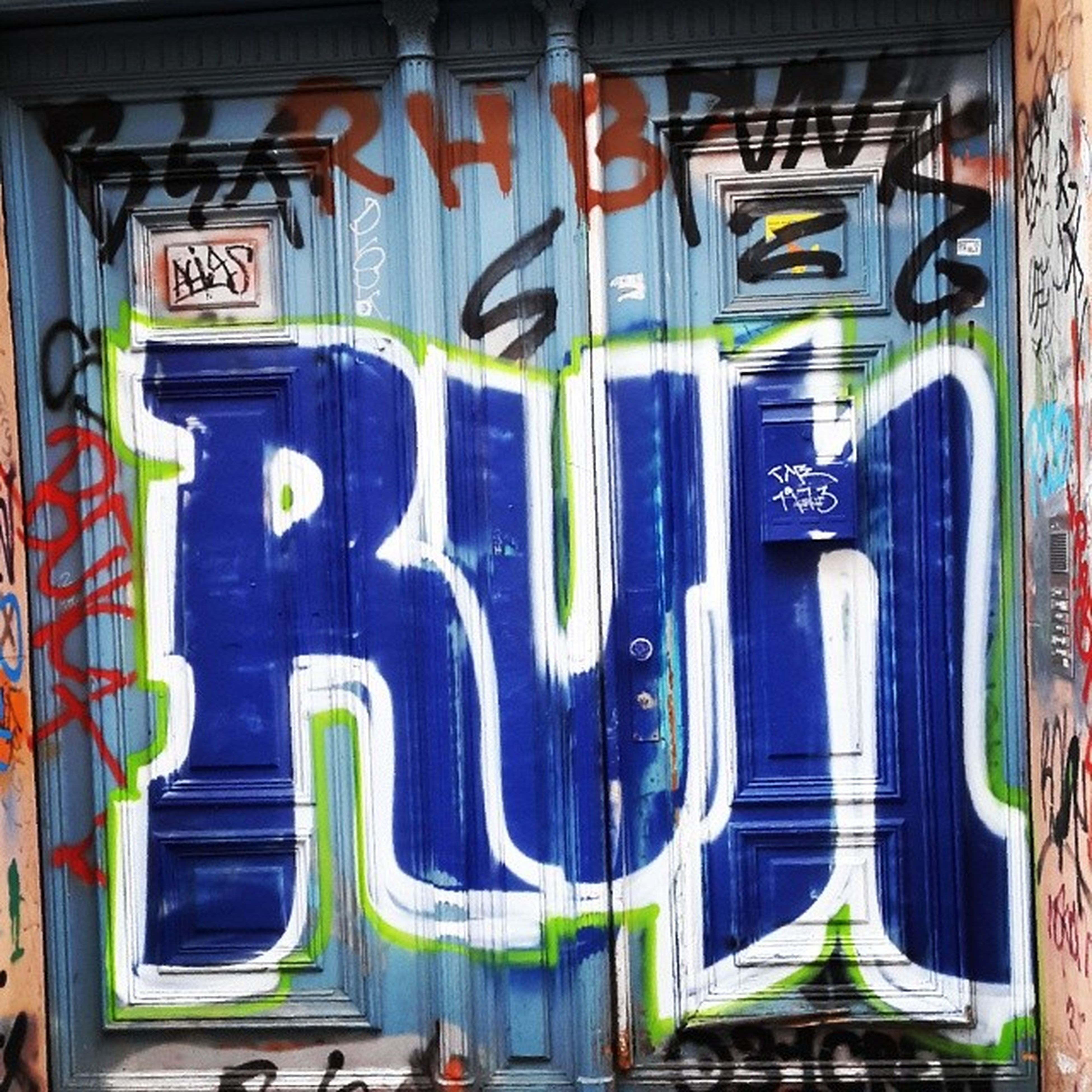 graffiti, art, multi colored, creativity, art and craft, built structure, architecture, wall - building feature, street art, building exterior, human representation, text, colorful, wall, no people, vandalism, mural, day, outdoors, western script