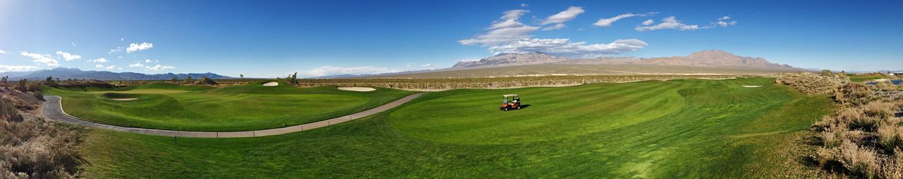 What a beautiful and serene golf course. Golf Golf Course Golfcourse Las Vegas Serenity Panorama Sun Mountain Desert IPhone 5S Sky Landscape Outdoors Clouds Blue Nature Beauty In Nature Golf Cart