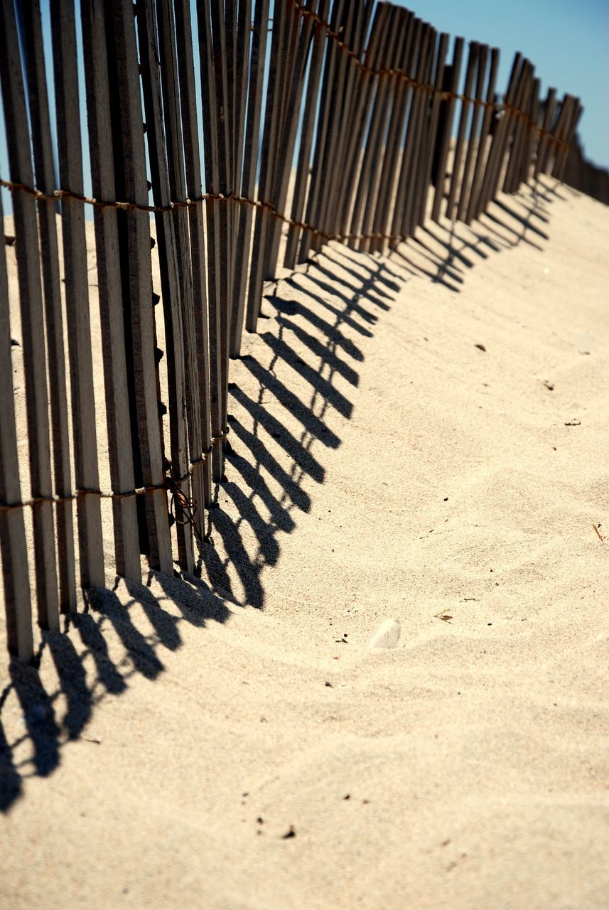 sand, beach, shadow, sunlight, day, no people, outdoors, close-up