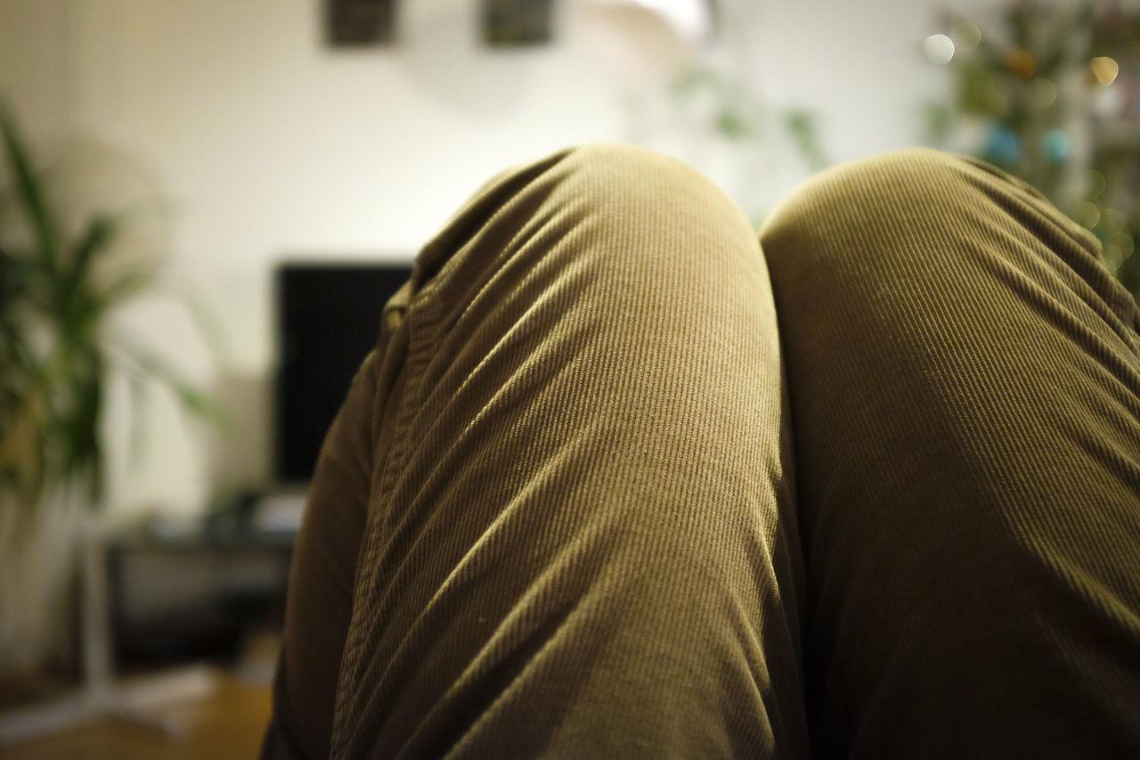 KNEES IN CORDUROY PANTS IN LIVING ROOM