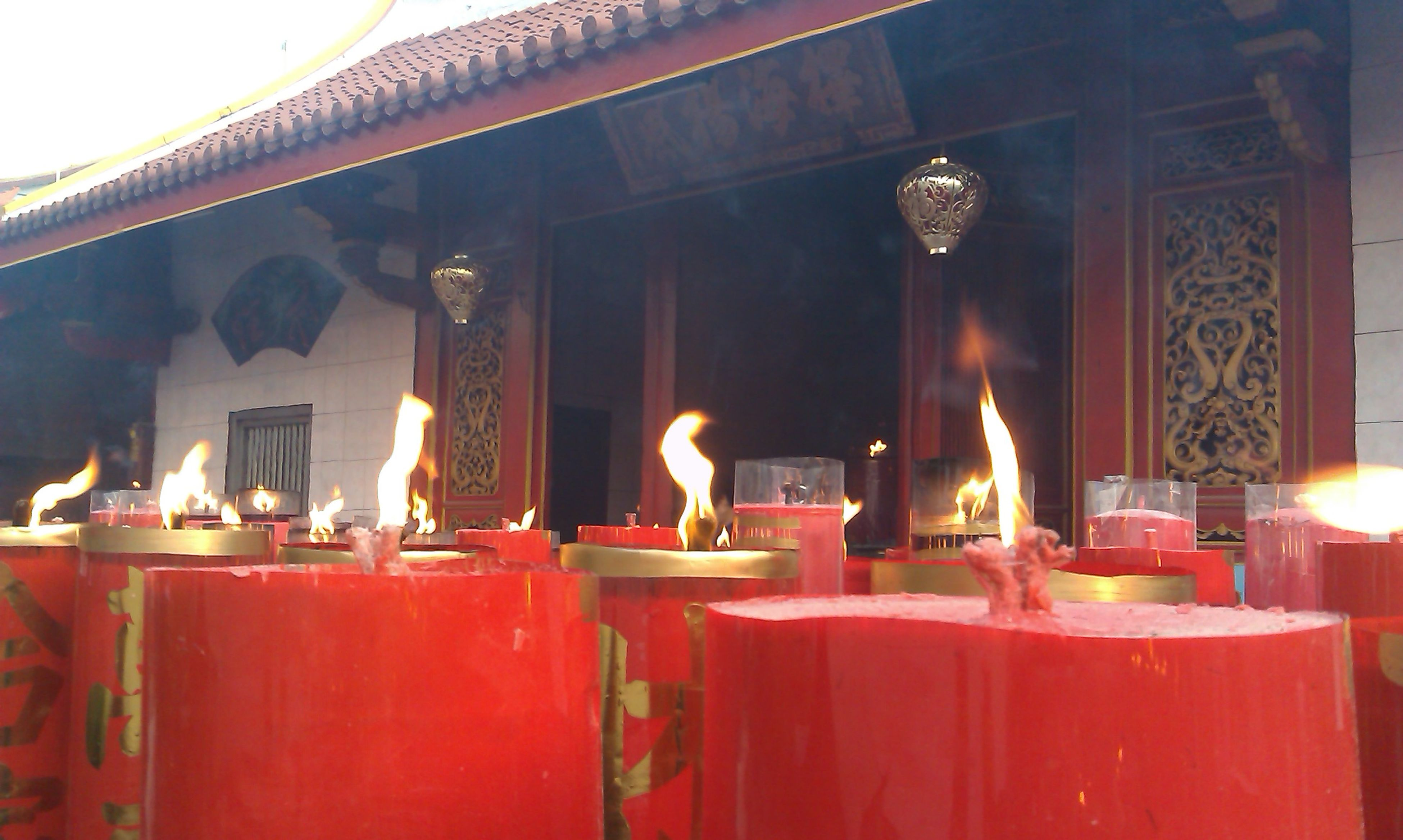 indoors, place of worship, religion, illuminated, spirituality, flame, burning, candle, built structure, architecture, temple - building, church, heat - temperature, fire - natural phenomenon, lit, glowing, no people, night